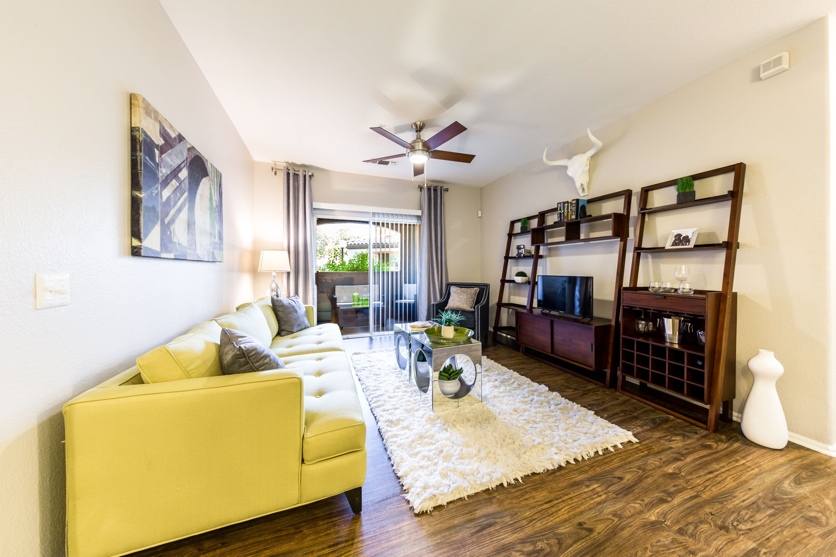 Living room with ceiling fan at Marquis at Arrowhead in Peoria, Arizona