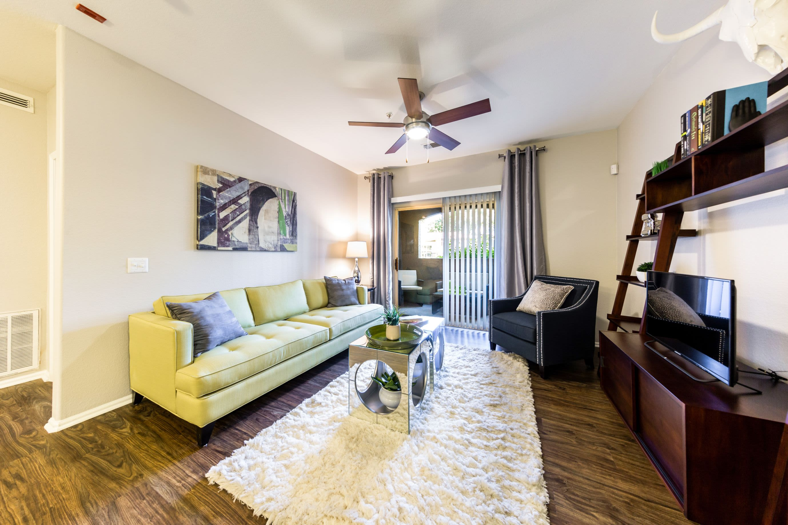 Living room with wood style floors at Marquis at Arrowhead in Peoria, Arizona