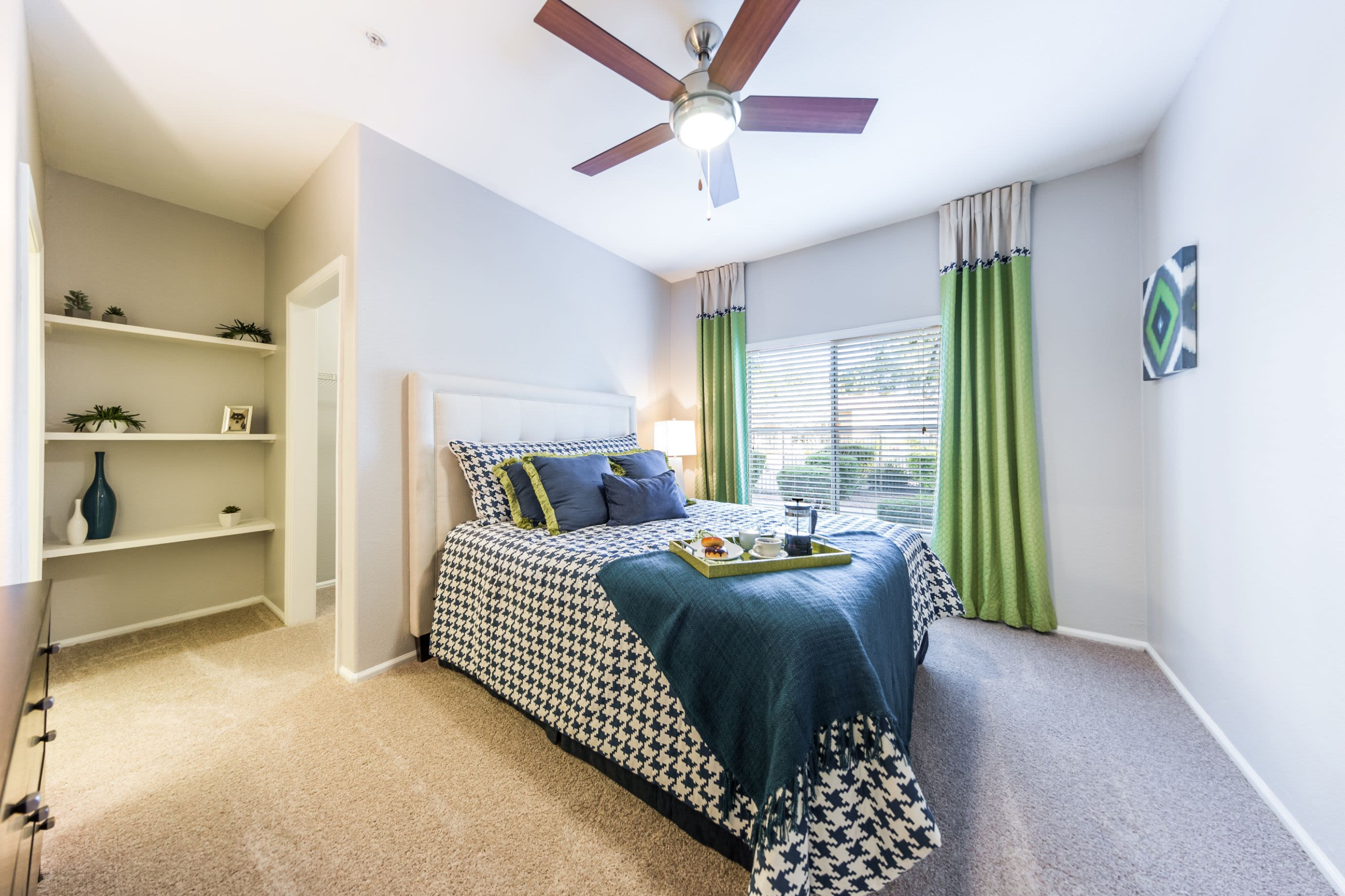 Bedroom with large window at Marquis at Arrowhead in Peoria, Arizona