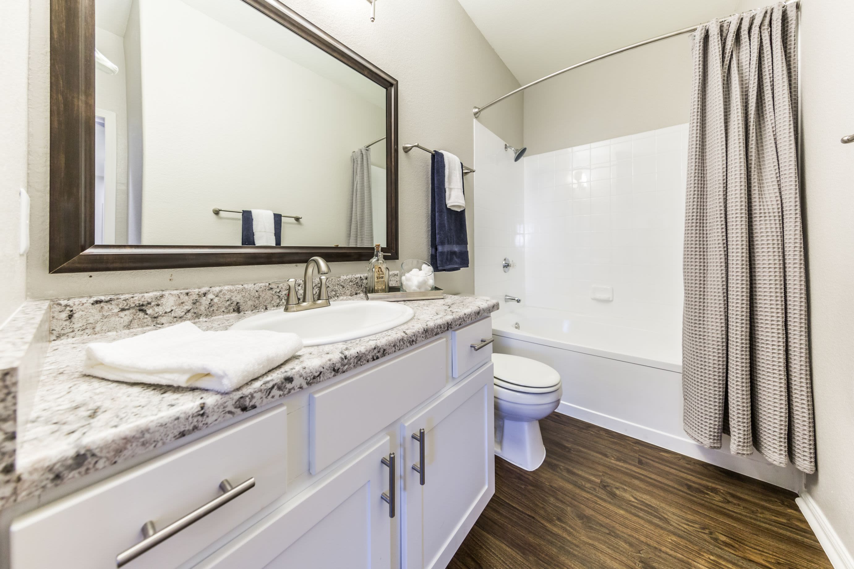 Bathroom with wood style floors at Marquis at Arrowhead in Peoria, Arizona