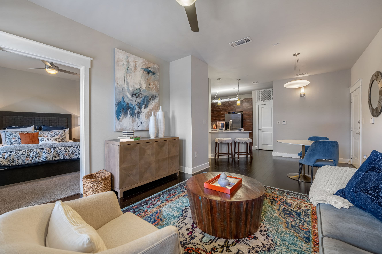 Living room with wood style flooring at Marquis Cresta Bella in San Antonio, Texas