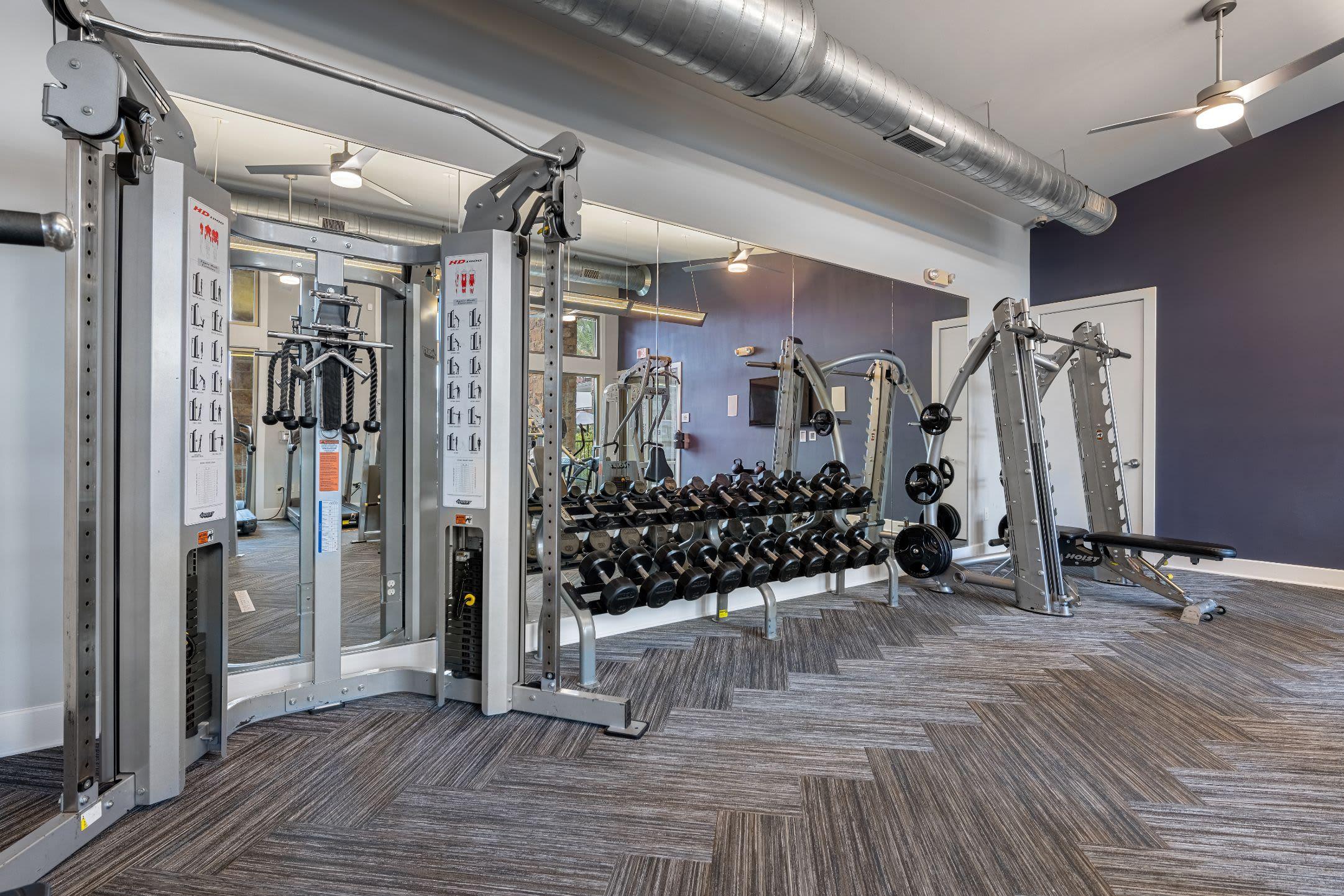 Free weights in fitness center at Marquis Cresta Bella in San Antonio, Texas