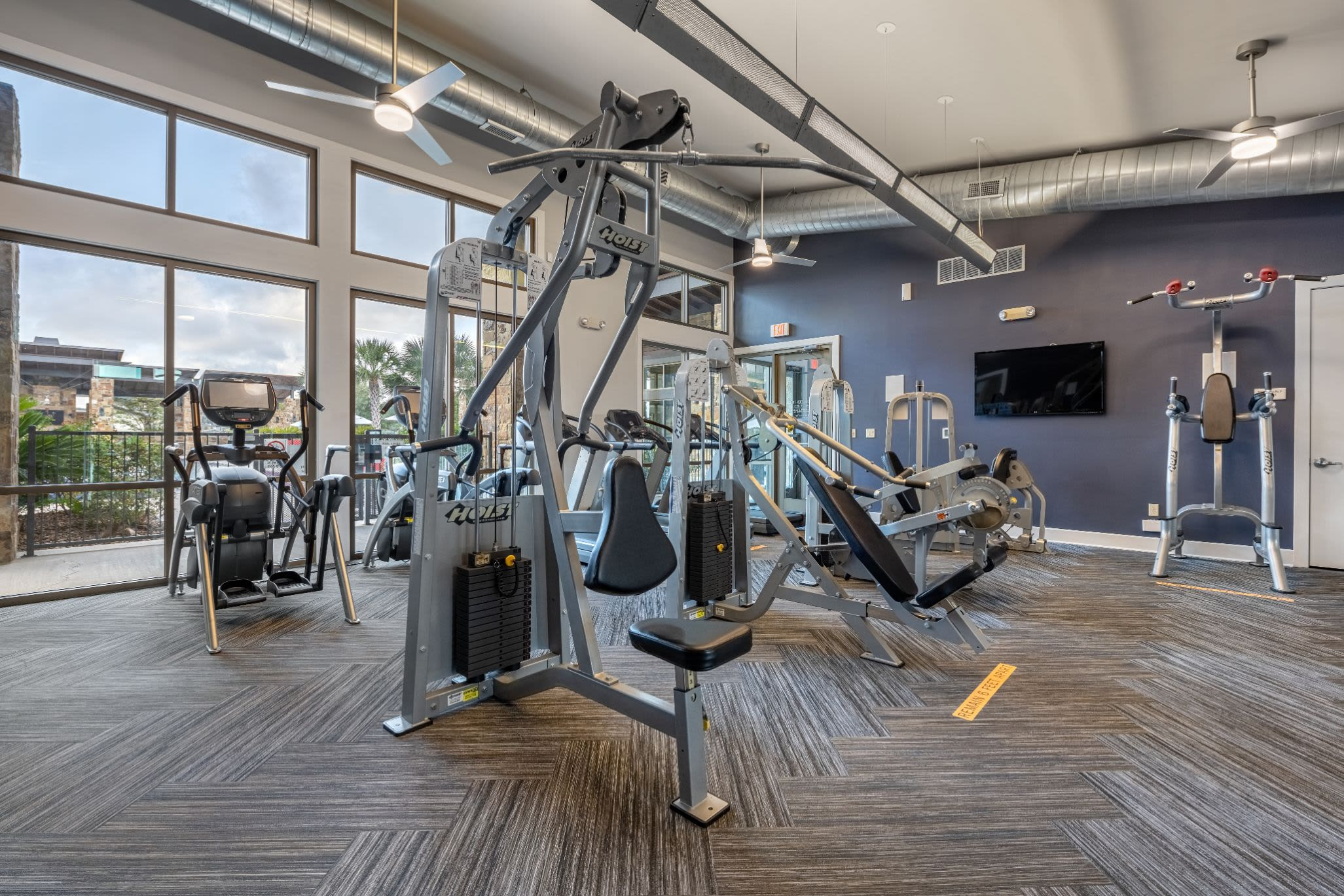 Fully equipped fitness center at Marquis Cresta Bella in San Antonio, Texas