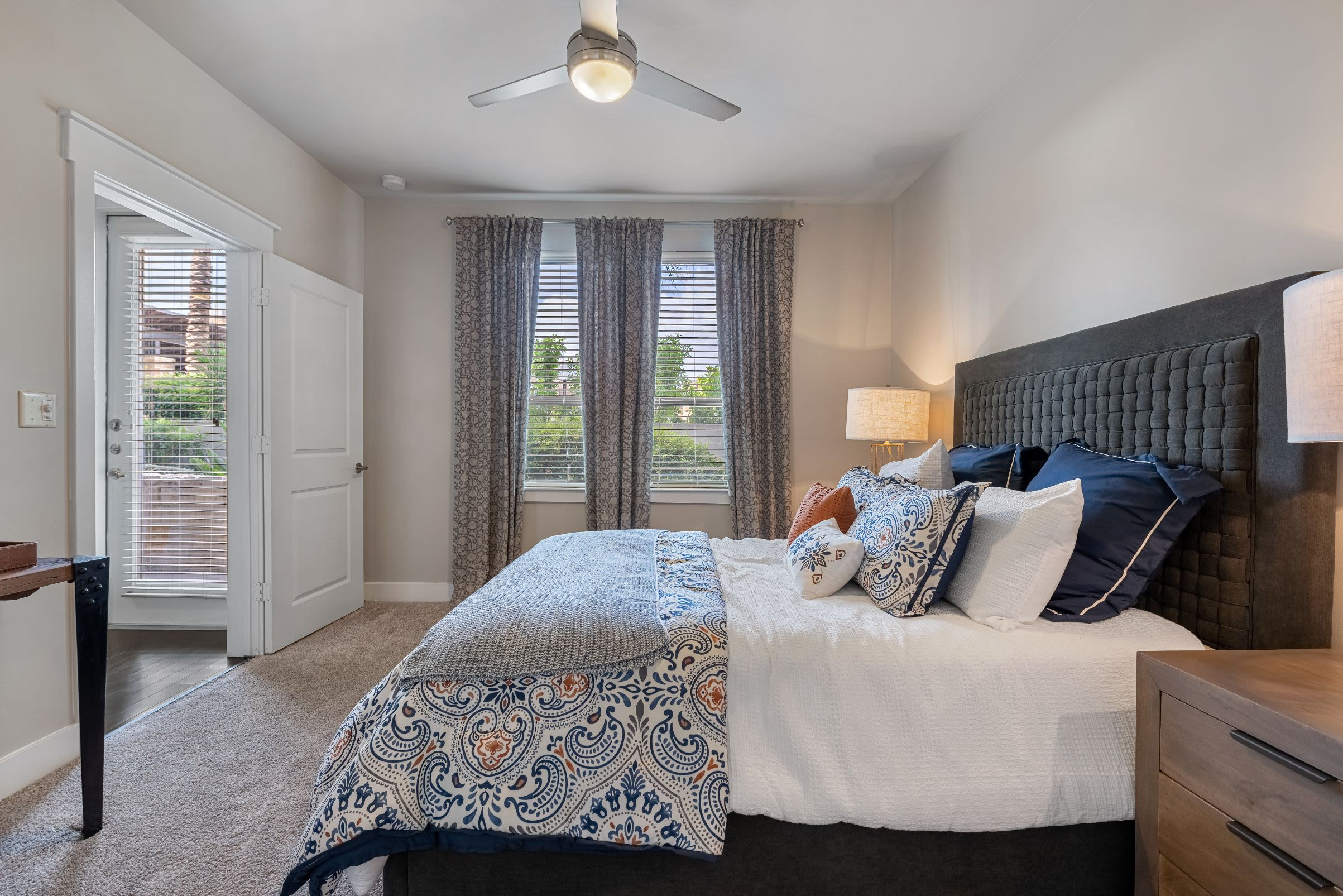 Bedroom with large window at Marquis Cresta Bella in San Antonio, Texas
