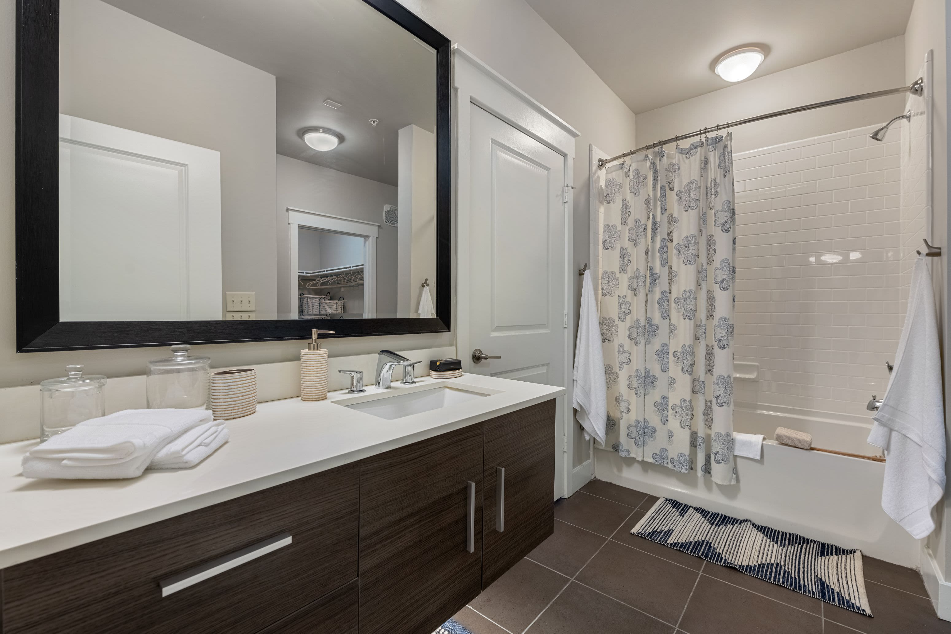 Bathroom with white countertops at Marquis Cresta Bella in San Antonio, Texas