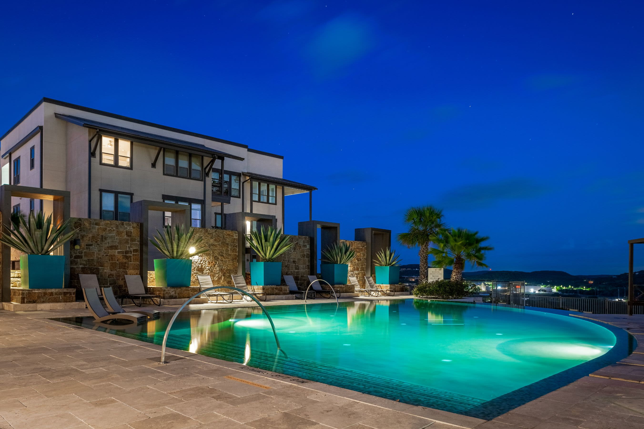 Swimming pool at night at Marquis Cresta Bella in San Antonio, Texas