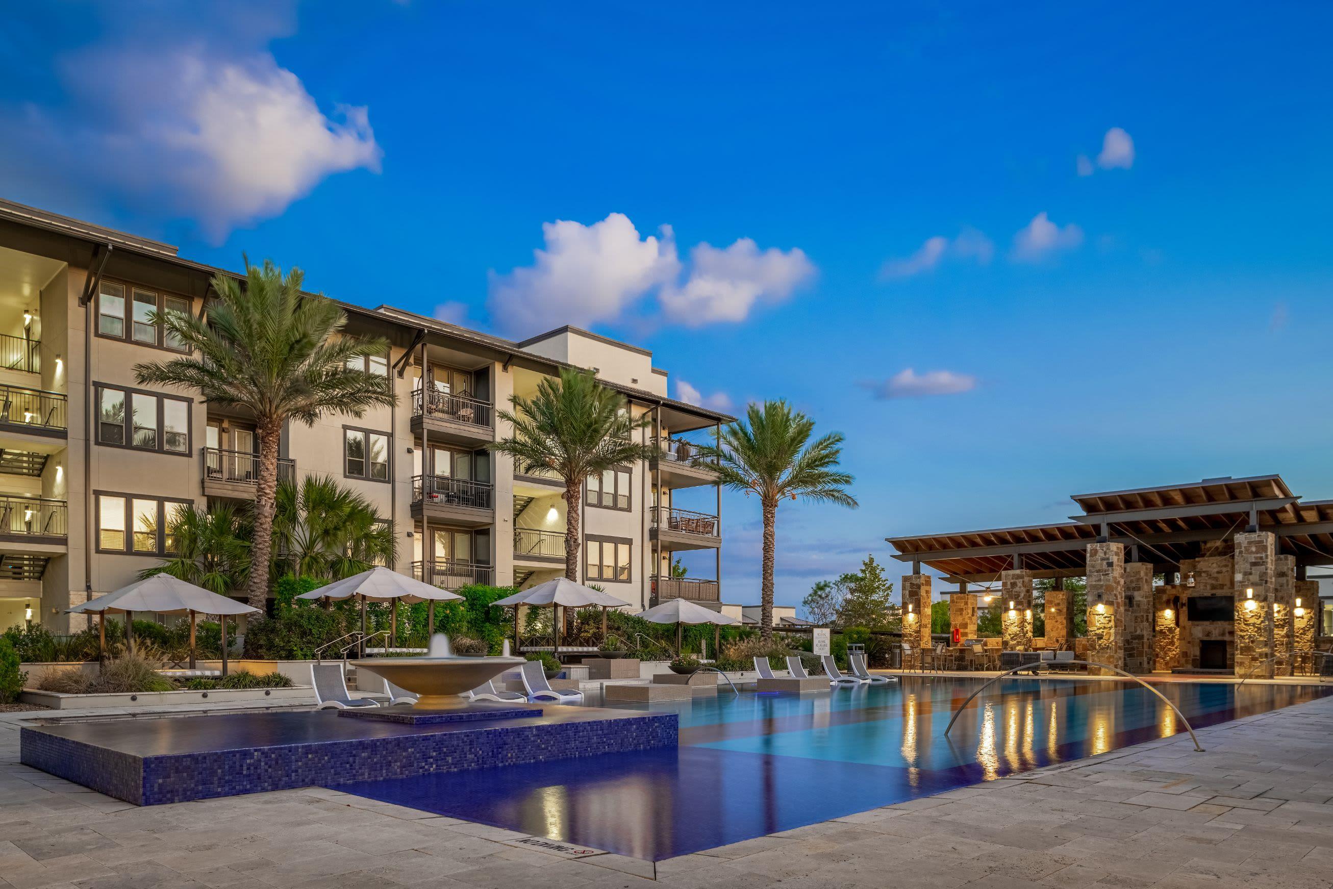 Glistening pool with palm trees San Antonio, Texas from Marquis Cresta Bella