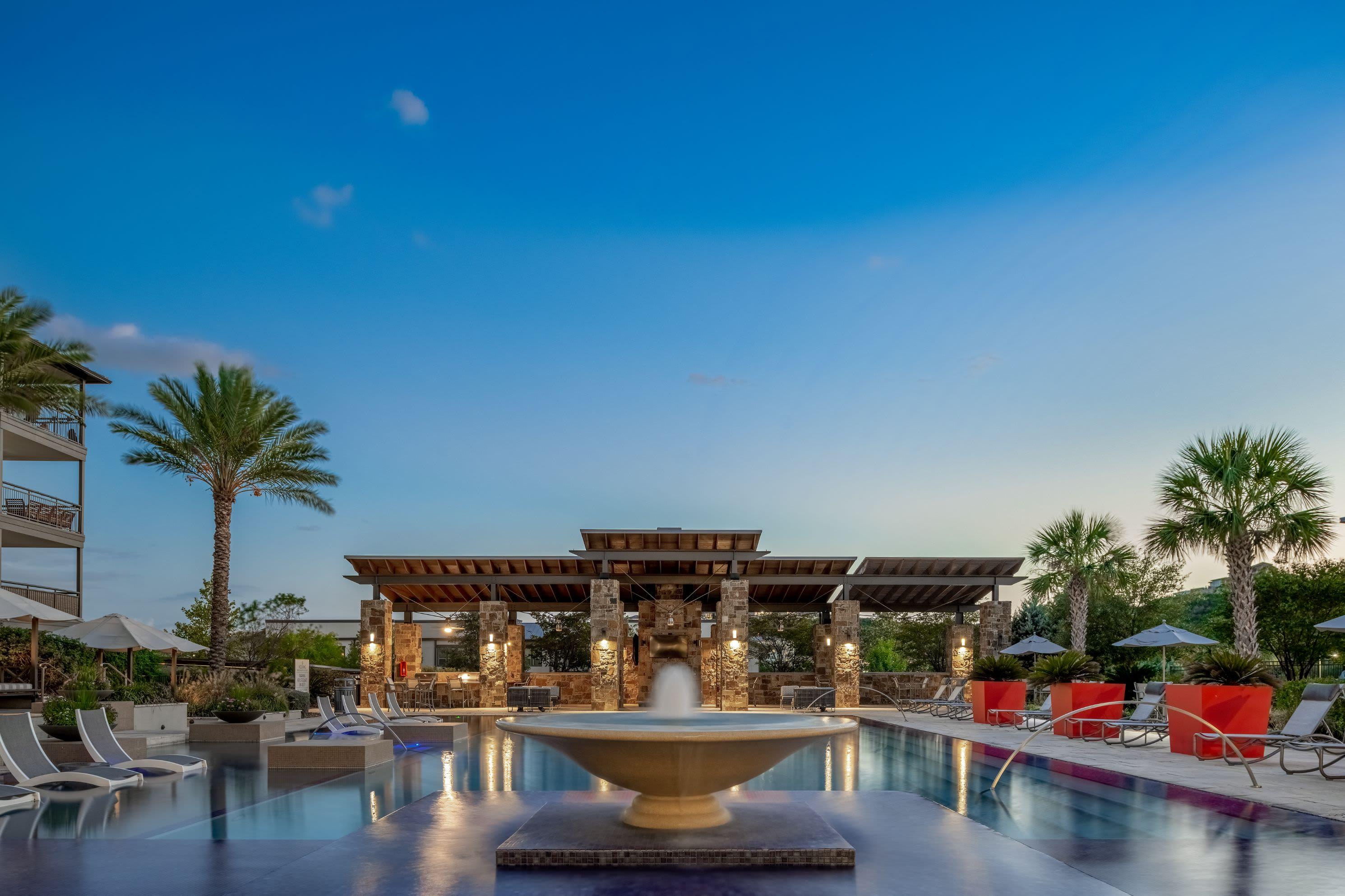 Swimming pool at dusk at Marquis Cresta Bella in San Antonio, Texas