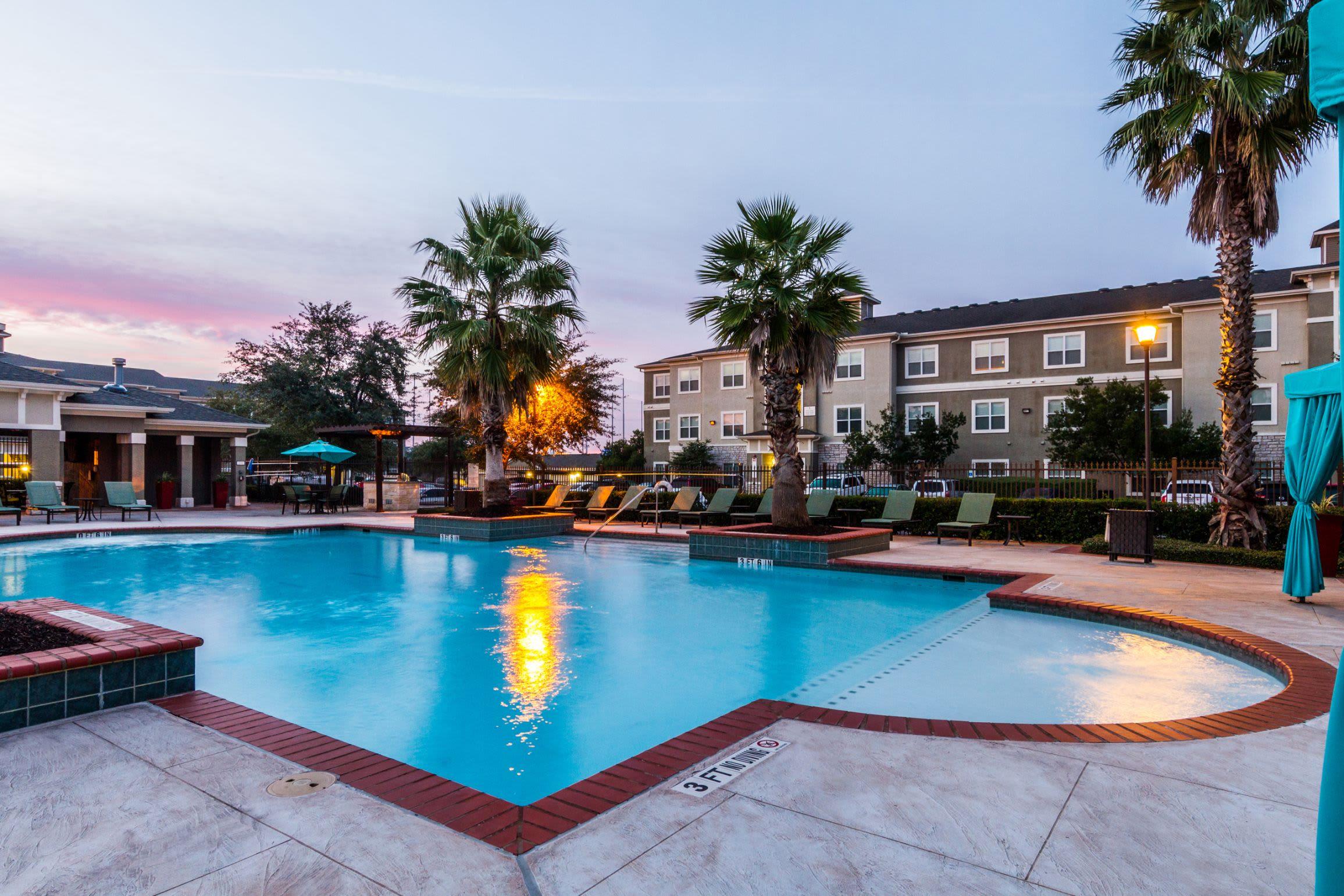 Resort-style swimming pool at Marquis at The RIM in San Antonio, Texas