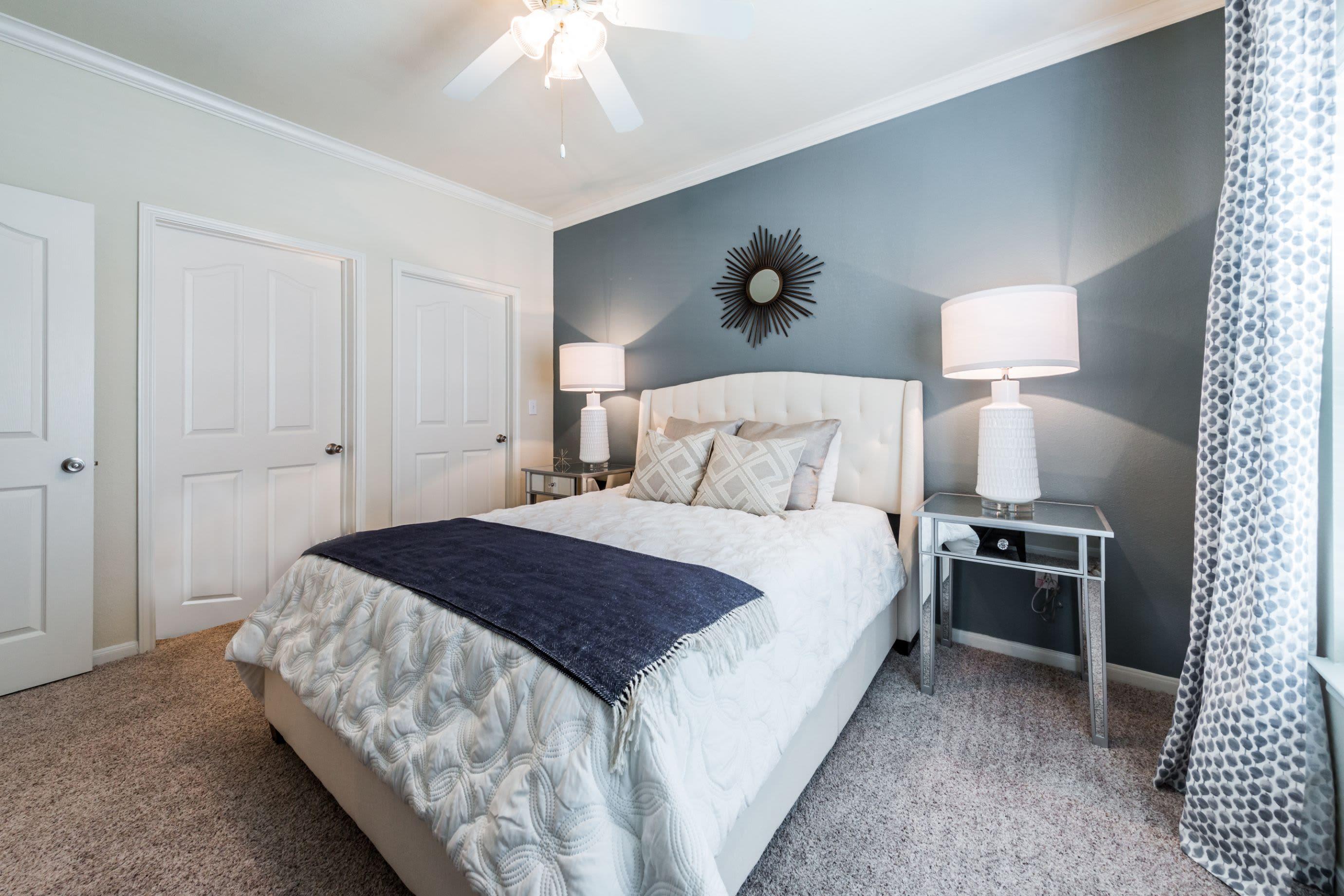 Bedroom with carpet flooring at Marquis at The RIM in San Antonio, Texas
