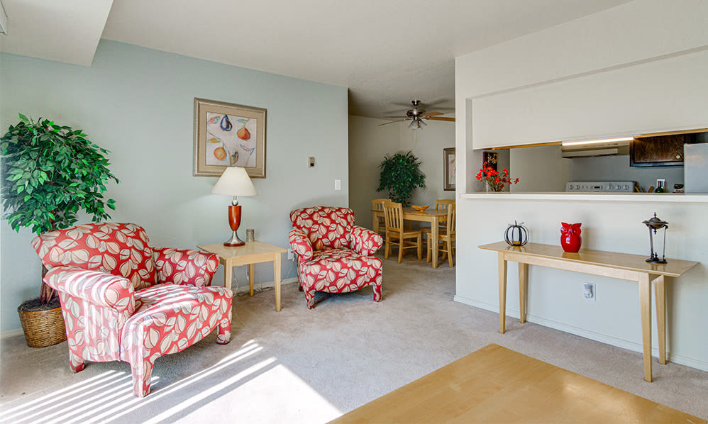 Cozy living room at Autumn Woods Apartments & Townhomes in Jackson, Michigan