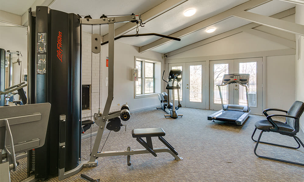 Fully-equipped fitness center at Autumn Woods Apartments & Townhomes in Jackson, Michigan