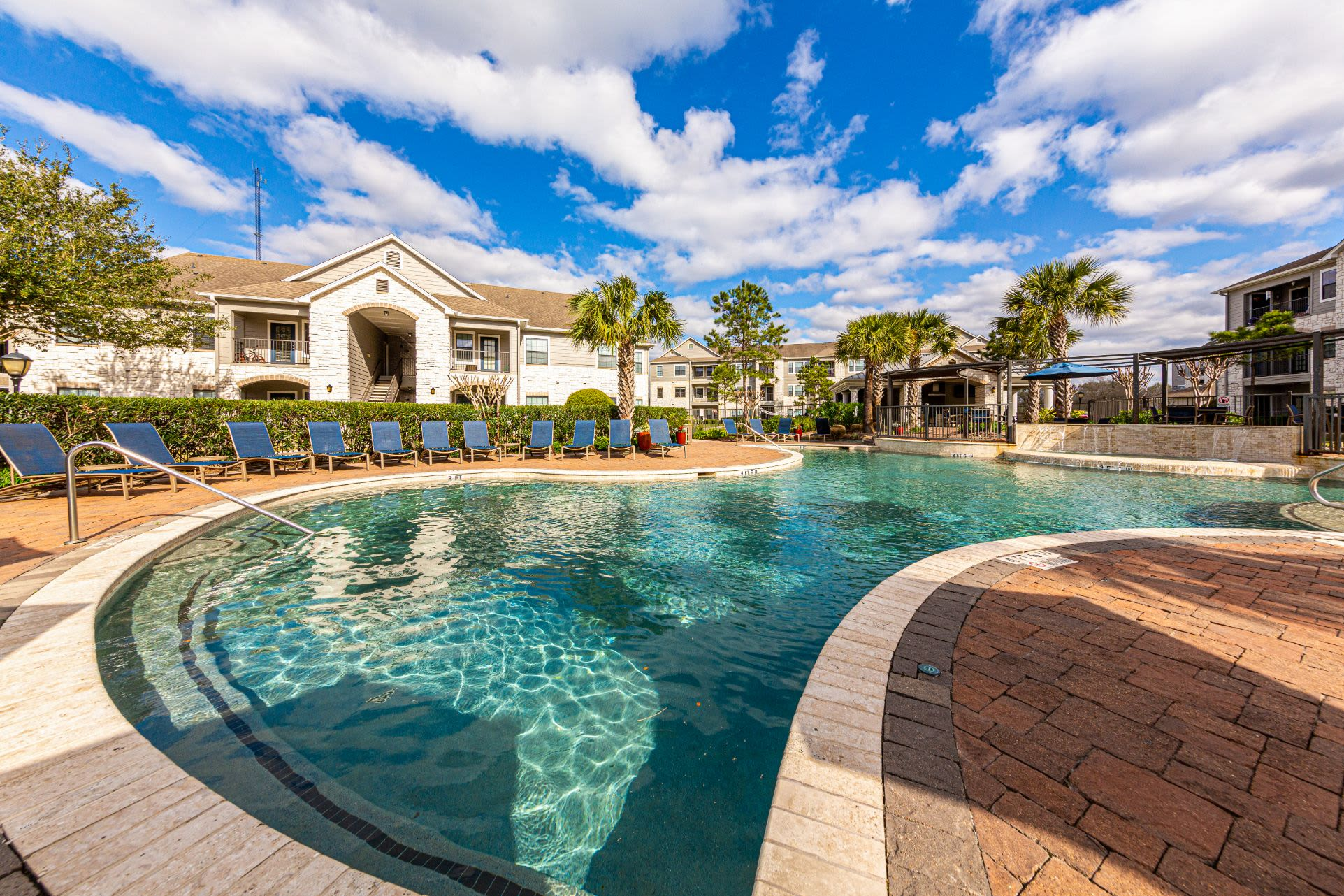 Resort style swimming pool at Marquis Grand Lakes in Richmond, Texas