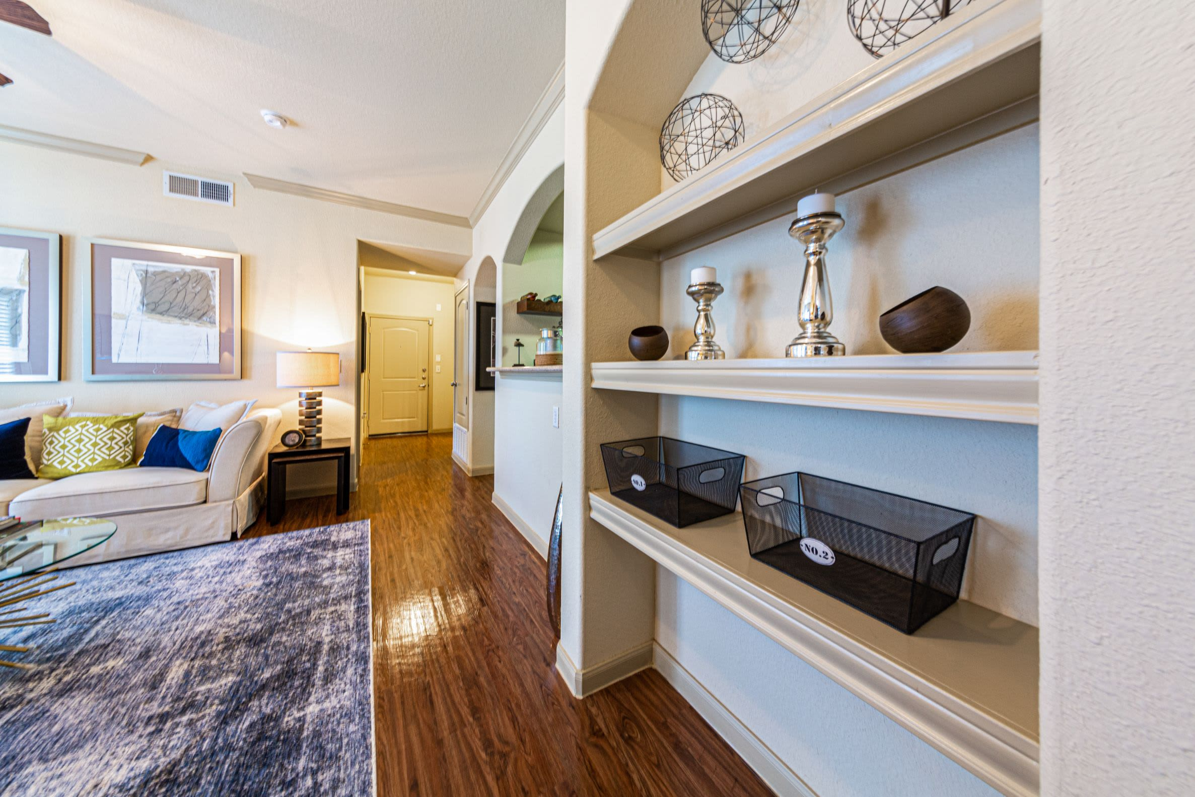 Living room with built in shelves at Marquis Grand Lakes in Richmond, Texas