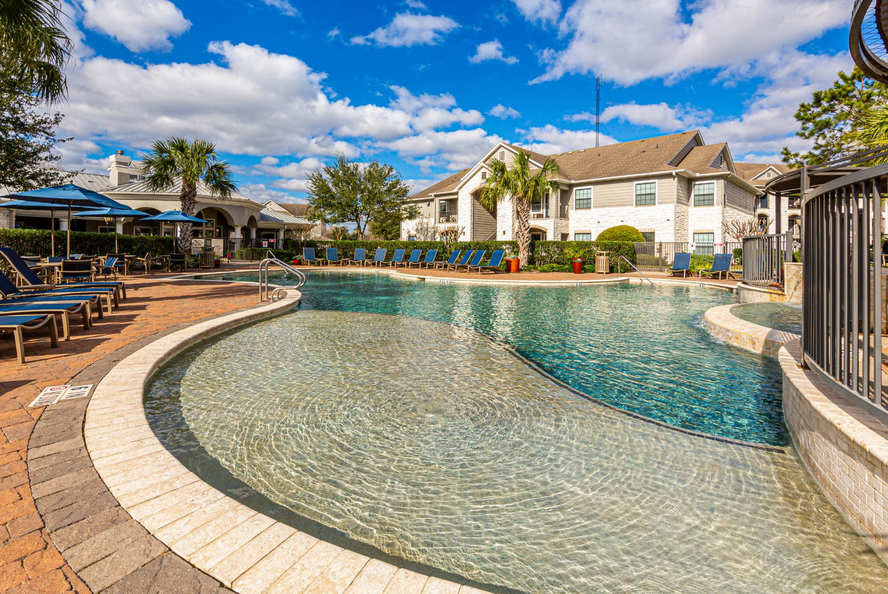 Sparkling swimming pool at Marquis Grand Lakes in Richmond, Texas