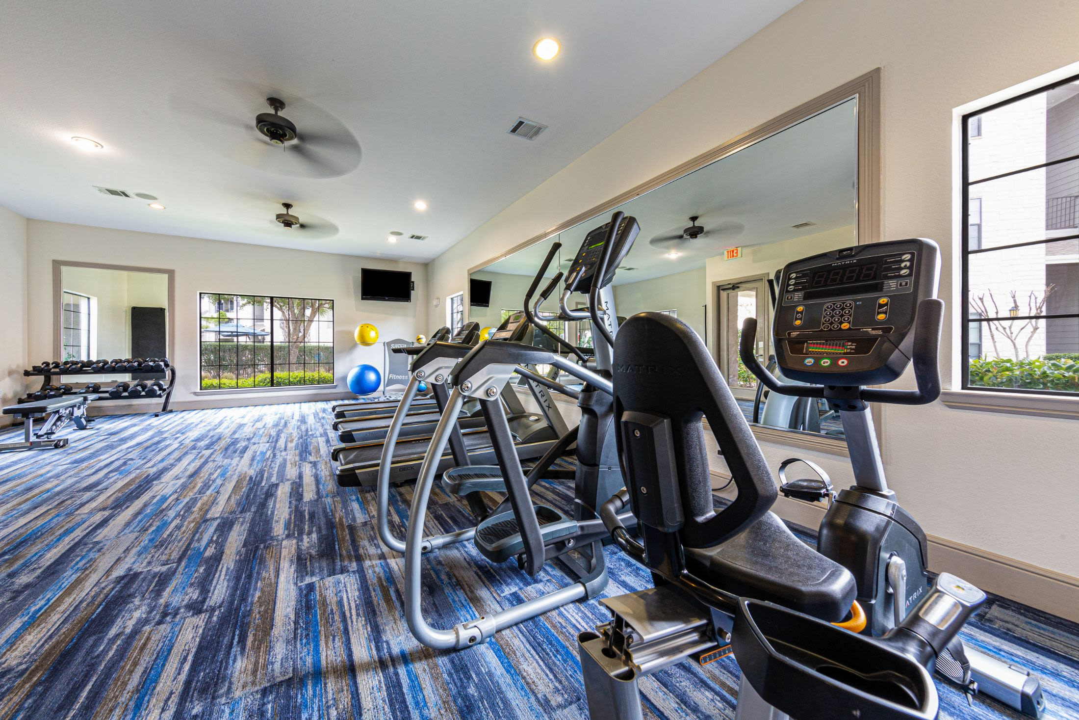 Fitness center at Marquis Grand Lakes in Richmond, Texas