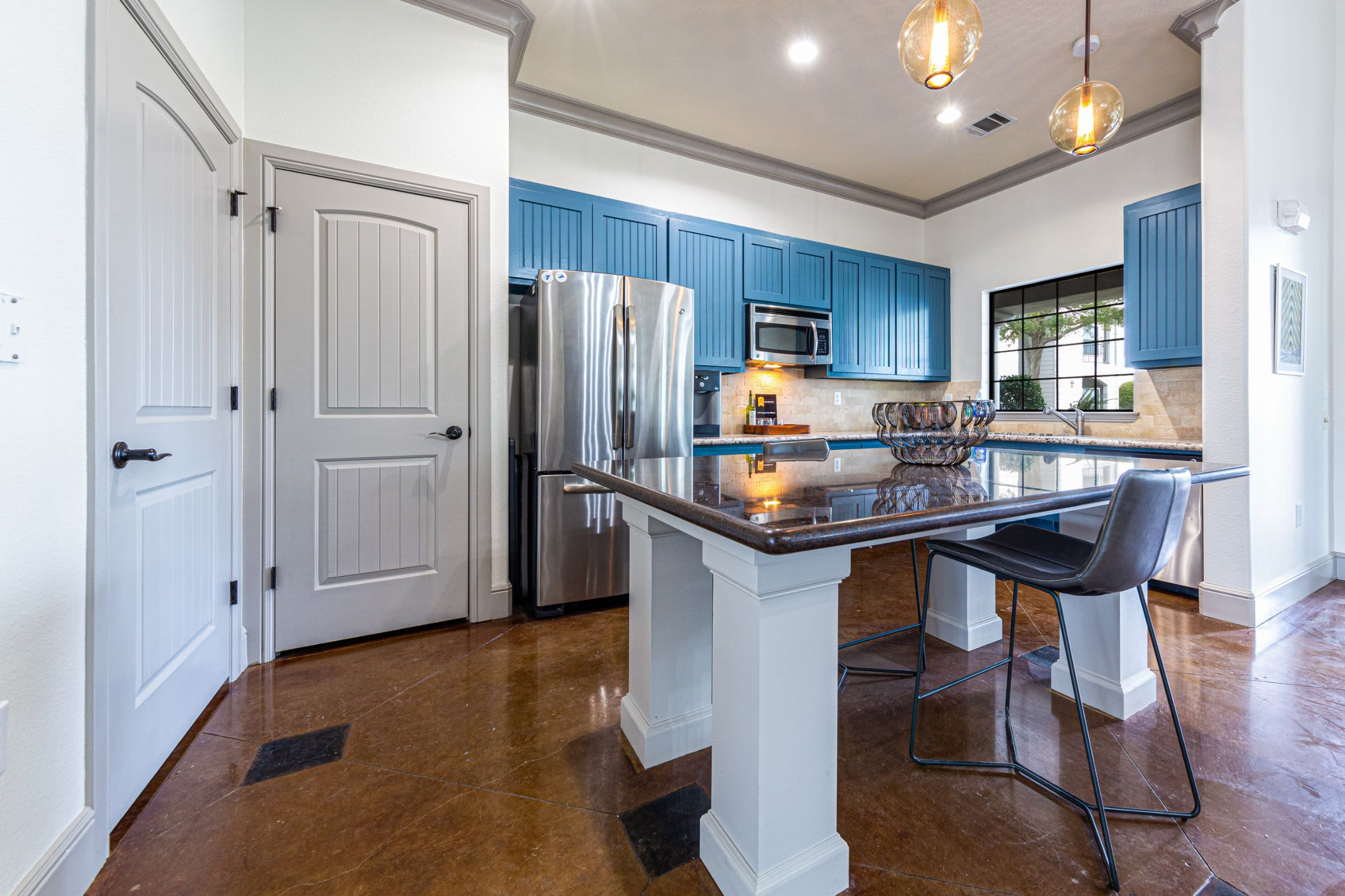 Kitchen in community clubhouse at Marquis Grand Lakes in Richmond, Texas