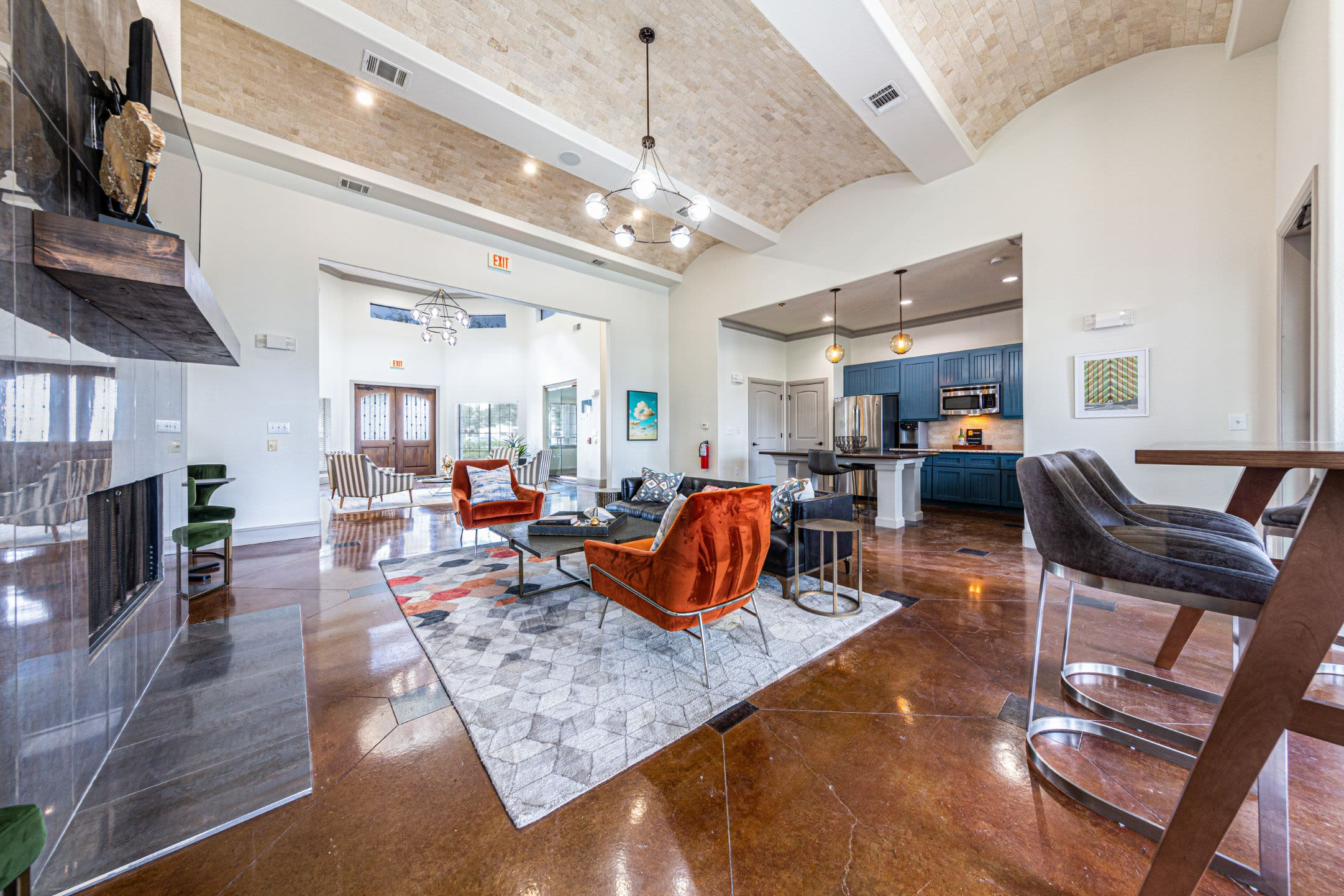 Spacious clubhouse with a large rug at Marquis Grand Lakes in Richmond, Texas