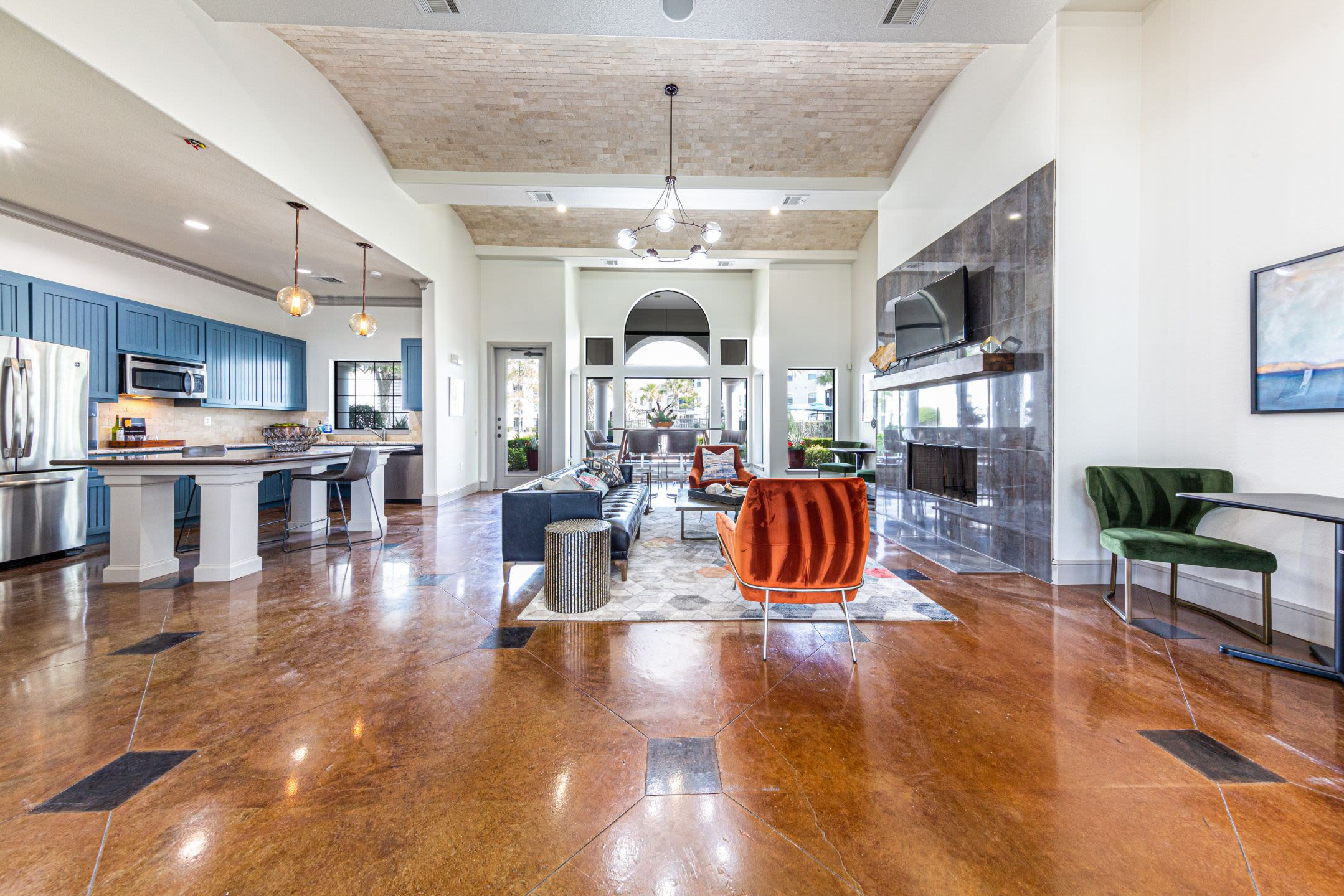 Spacious clubhouse with wood style floors at Marquis Grand Lakes in Richmond, Texas