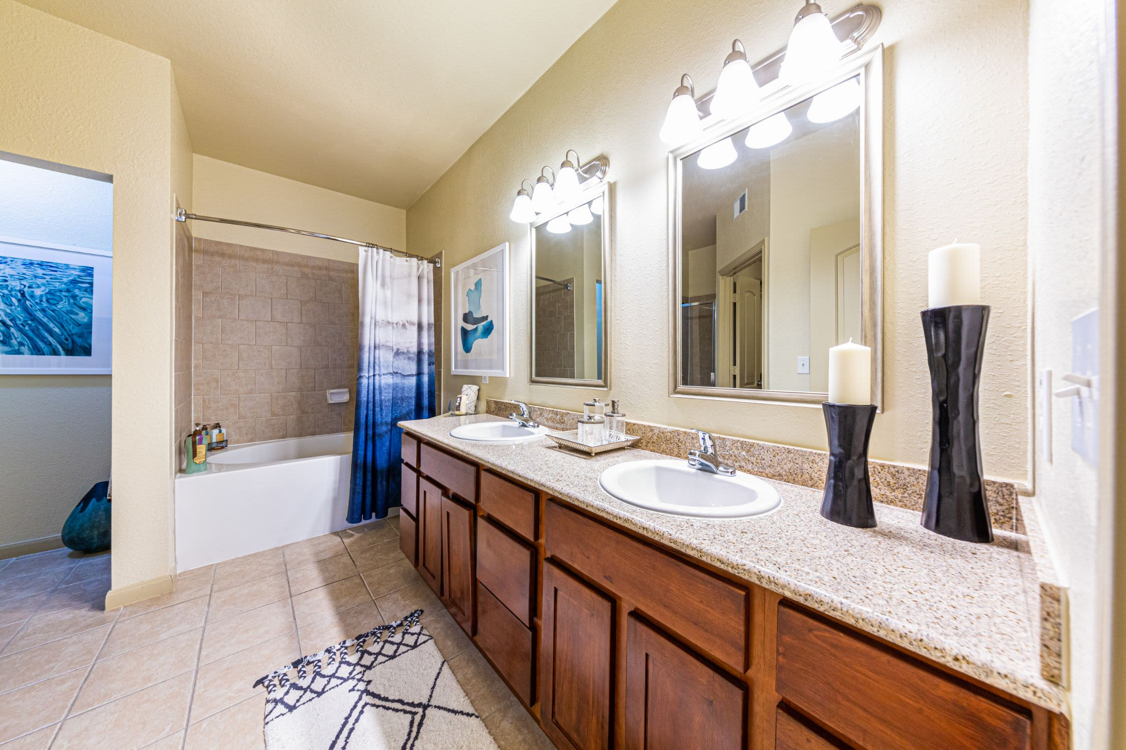 Bathroom with white countertops at Marquis Grand Lakes in Richmond, Texas