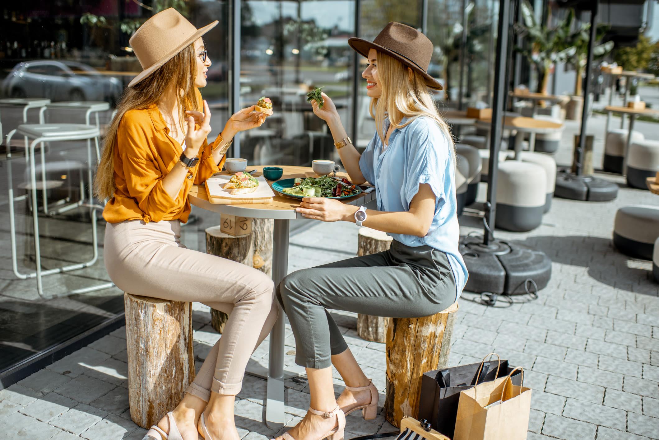 Residents eating outdoors near Highland Square in Atlanta, Georgia