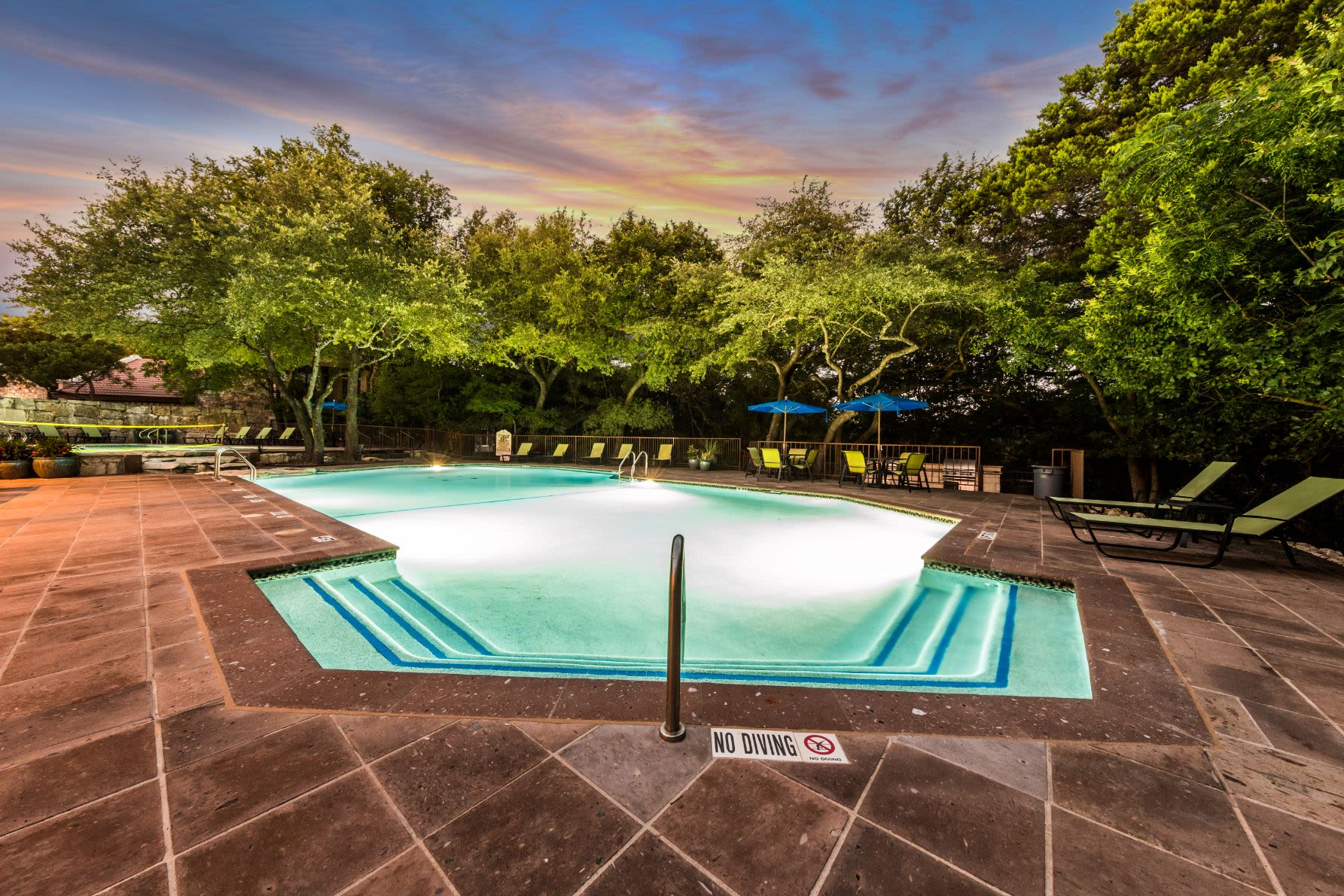 Swimming pool with underwater lights at Marquis at Caprock Canyon in Austin, Texas