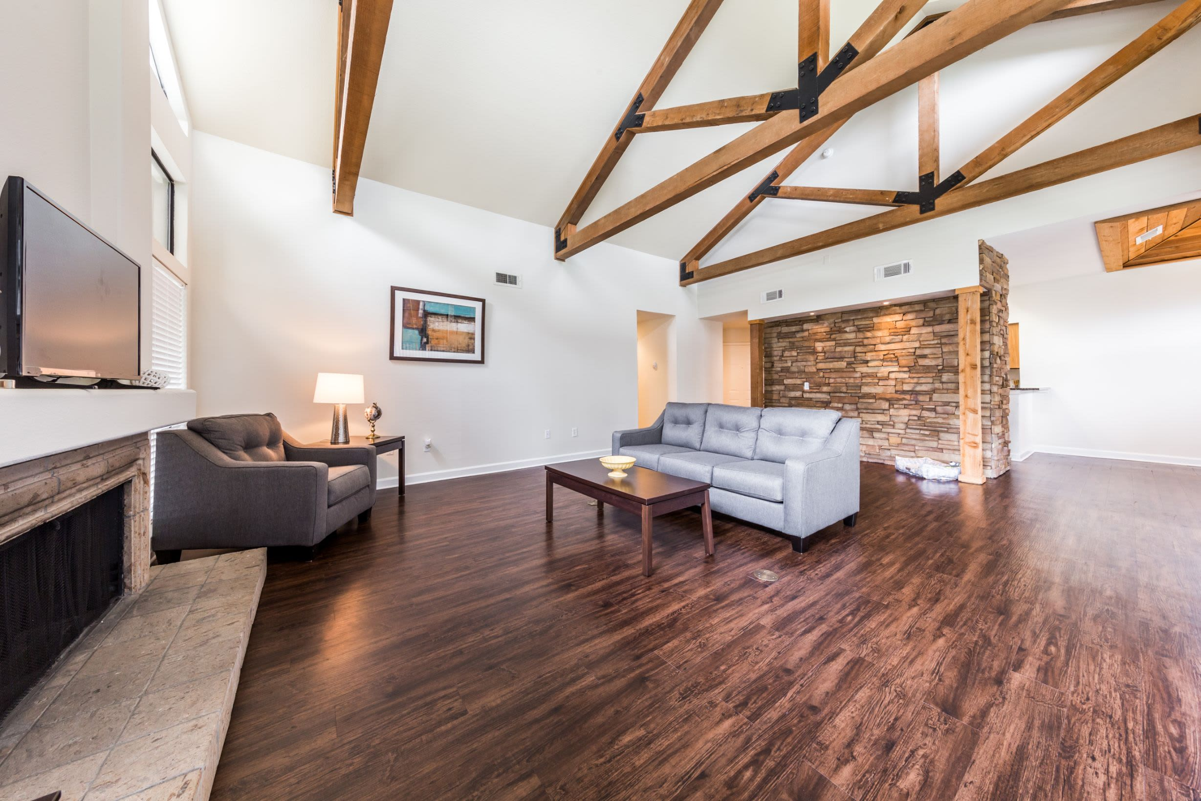 Spacious living room with fireplace at Marquis at Caprock Canyon in Austin, Texas