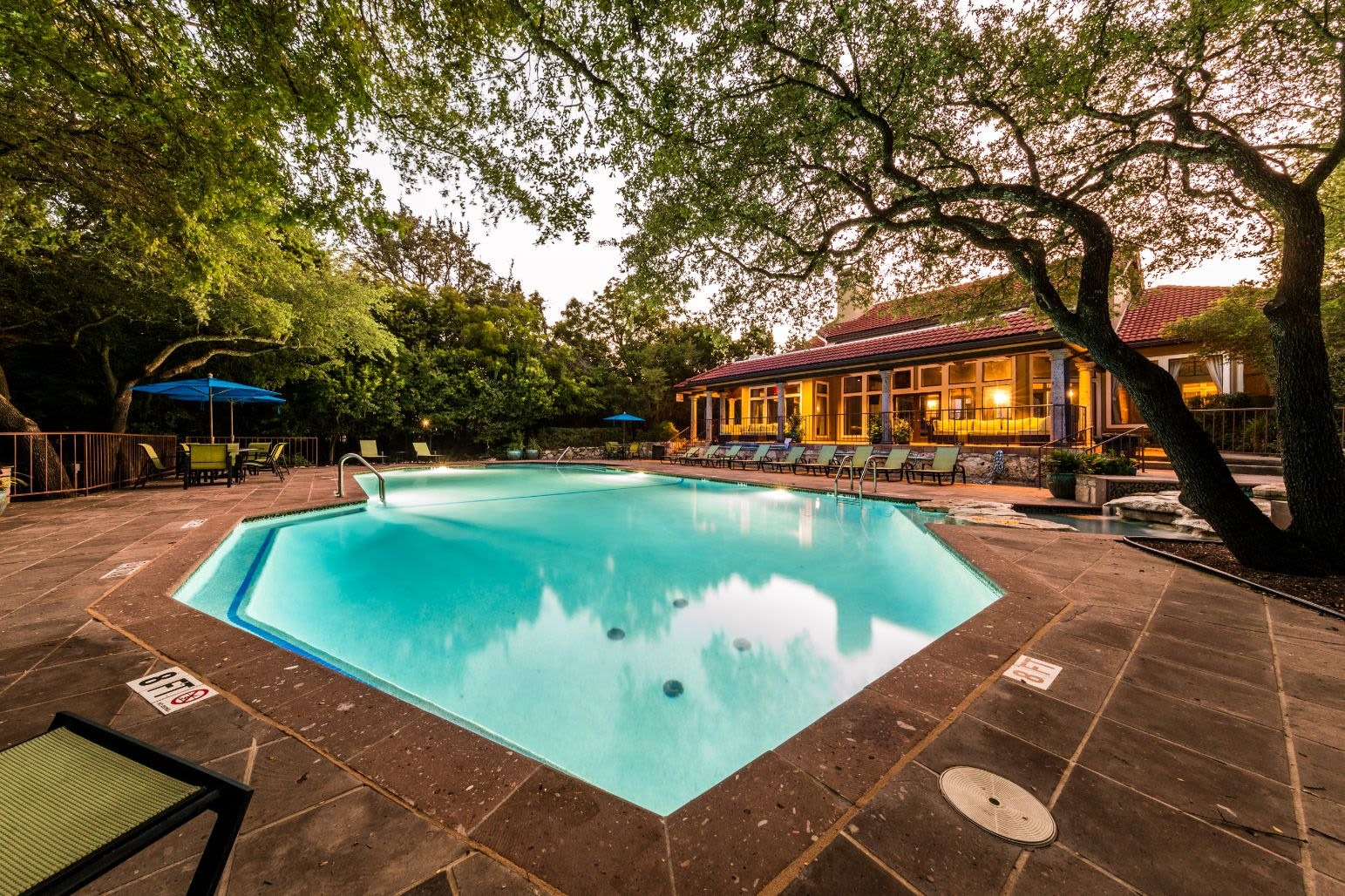 Swimming pool with sun chairs at Marquis at Caprock Canyon in Austin, Texas
