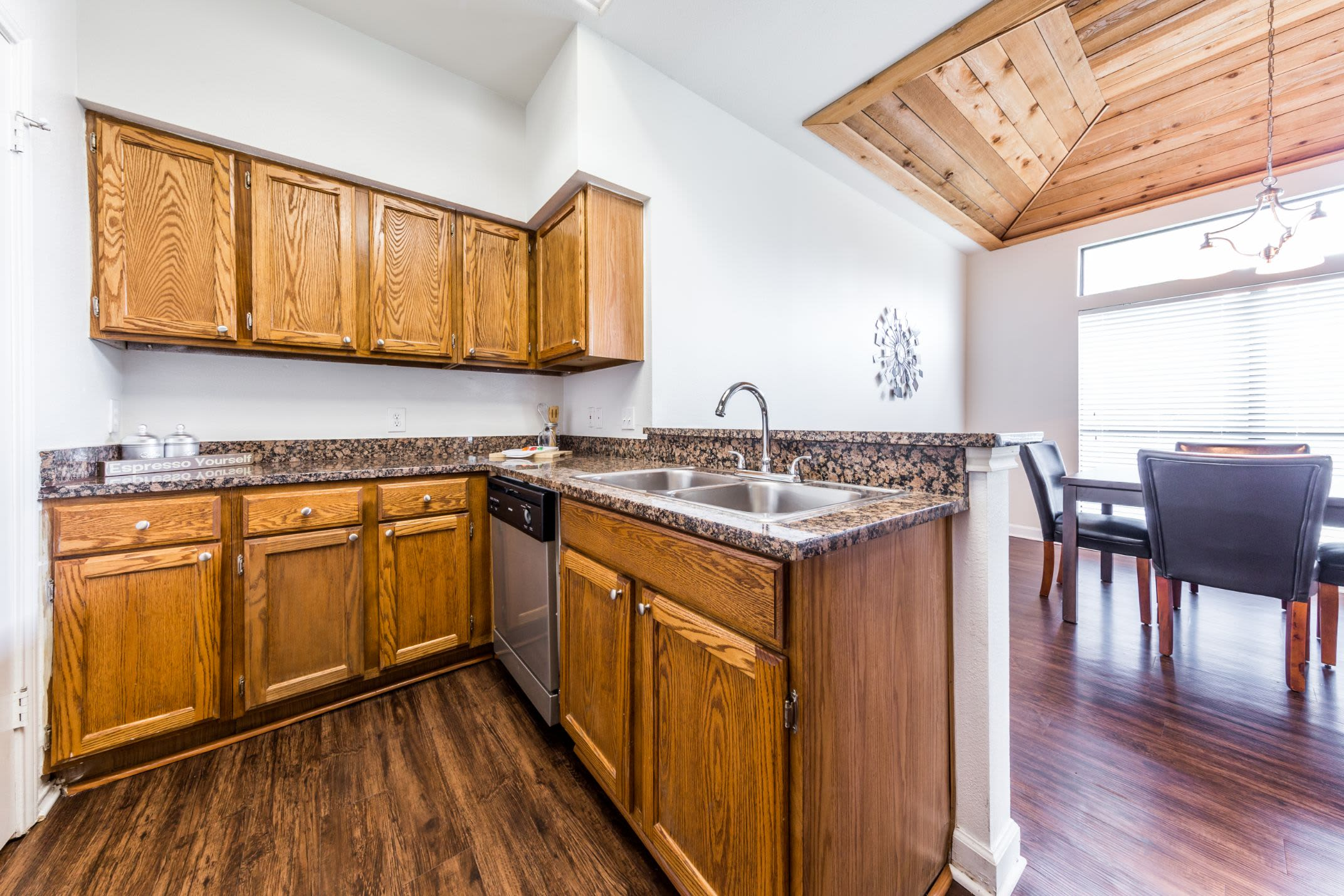 Kitchen with wood style floors at Marquis at Caprock Canyon in Austin, Texas