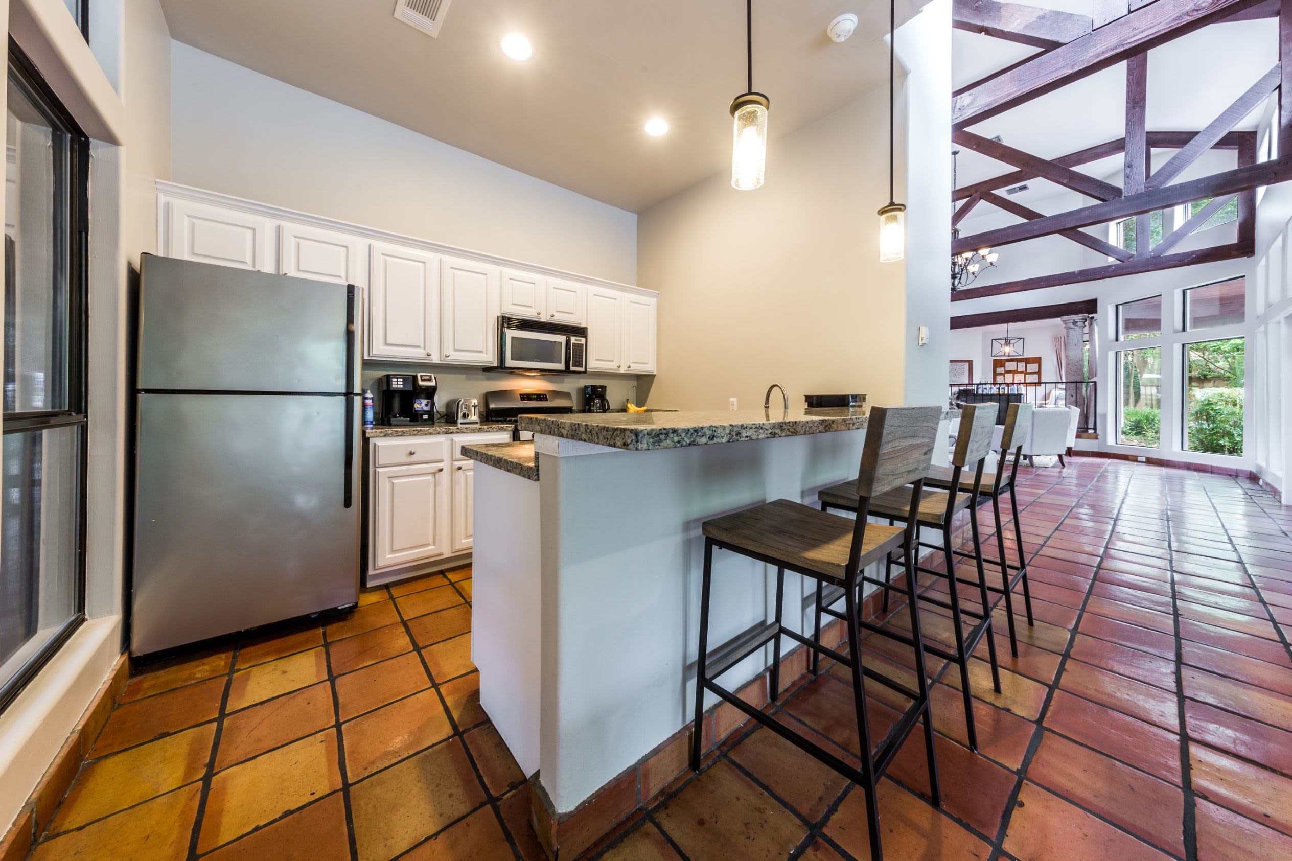 Kitchen and breakfast bar in clubhouse at Marquis at Caprock Canyon in Austin, Texas