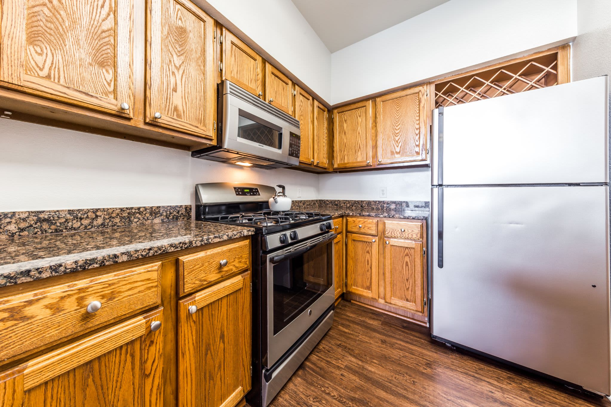 Kitchen with a large fridge at Marquis at Caprock Canyon in Austin, Texas