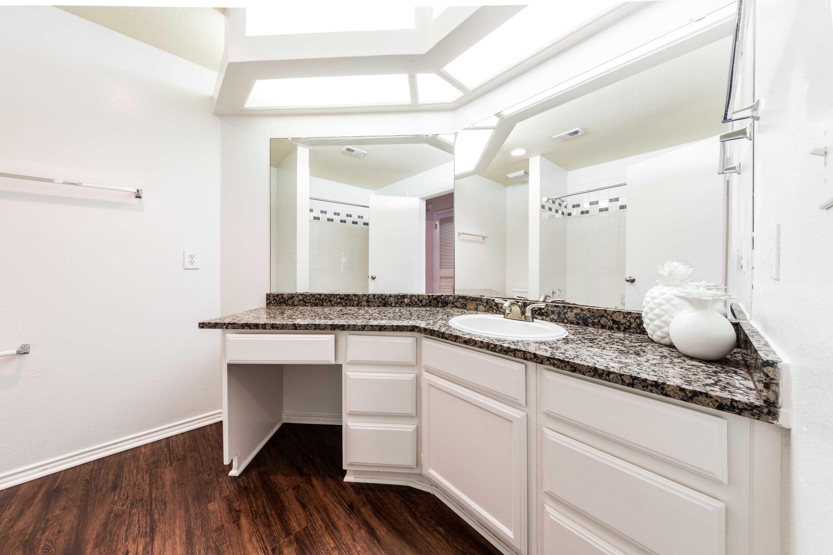 Large vanity with white cabinets at Marquis at Caprock Canyon in Austin, Texas