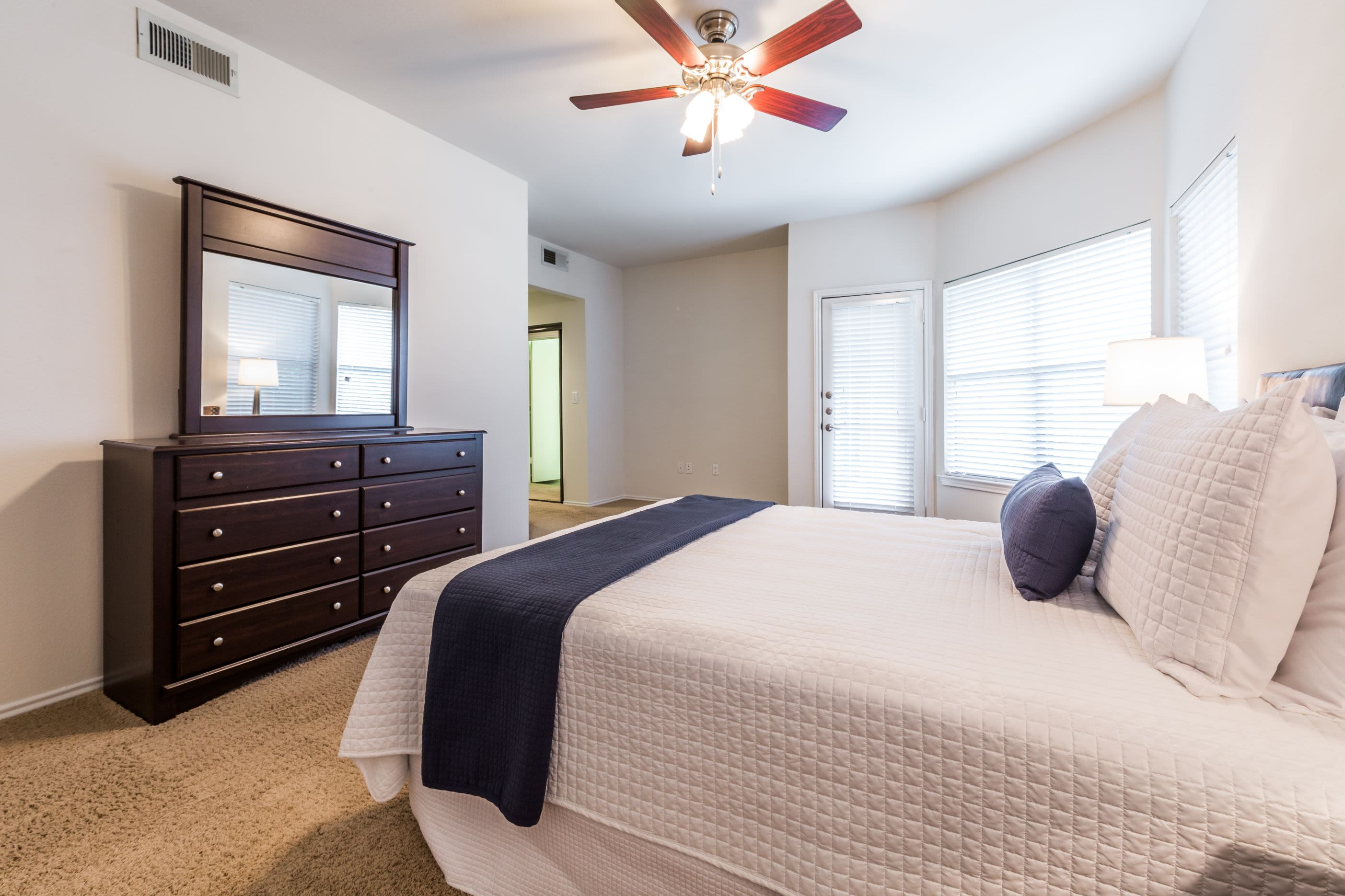 Bedroom with ceiling fan at Marquis at Caprock Canyon in Austin, Texas