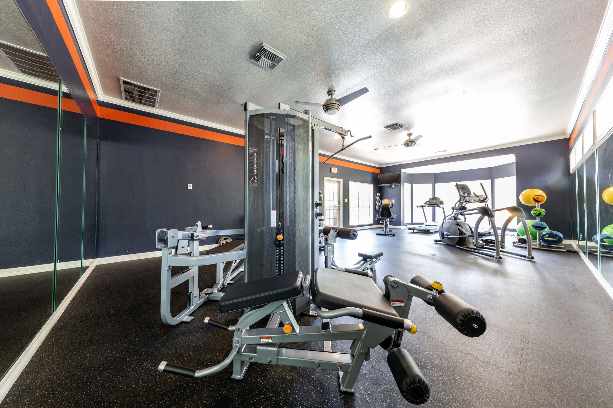 Weight machines in fitness center at Marquis at Deerfield in San Antonio, Texas