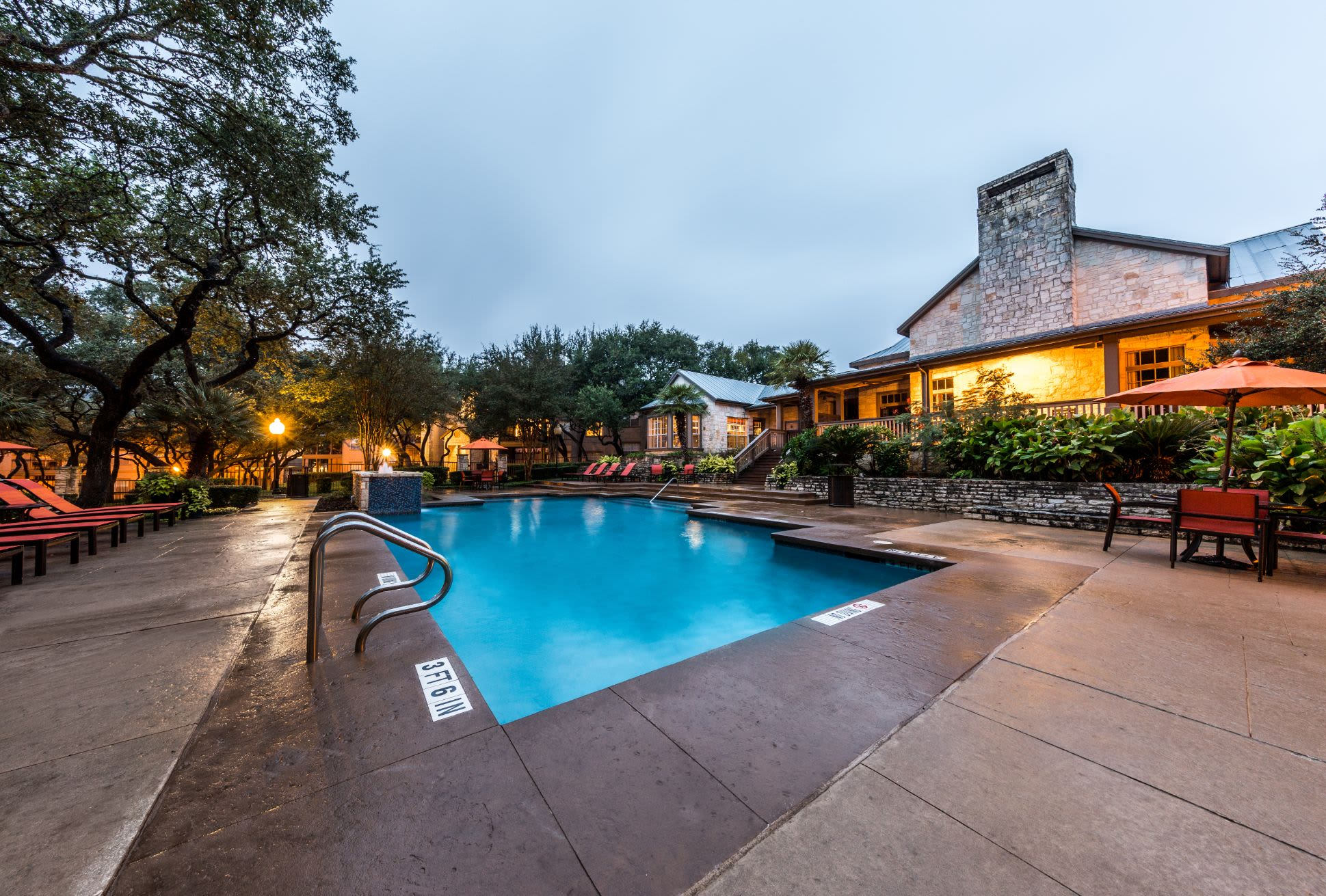 Swimming pool with sun chairs at Marquis at Deerfield in San Antonio, Texas