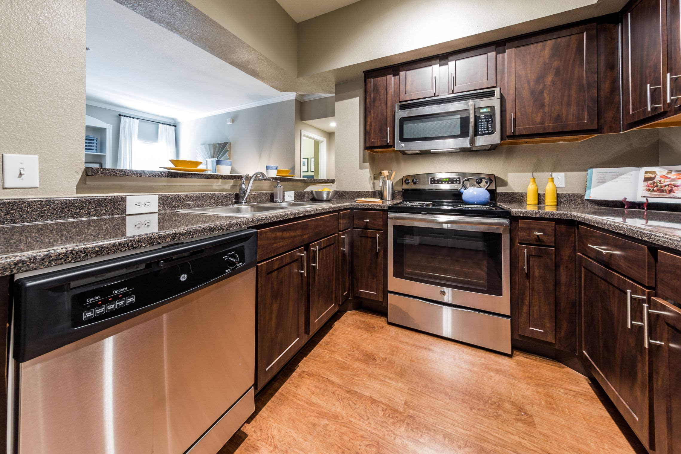 Kitchen with wood style floors at Marquis at Deerfield in San Antonio, Texas