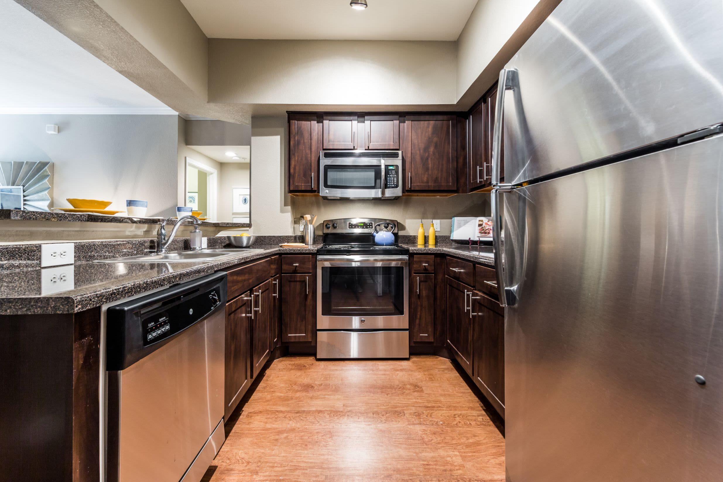Kitchen with modern appliances at Marquis at Deerfield in San Antonio, Texas