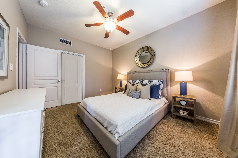 Bedroom with carpet floors at Marquis at Deerfield in San Antonio, Texas