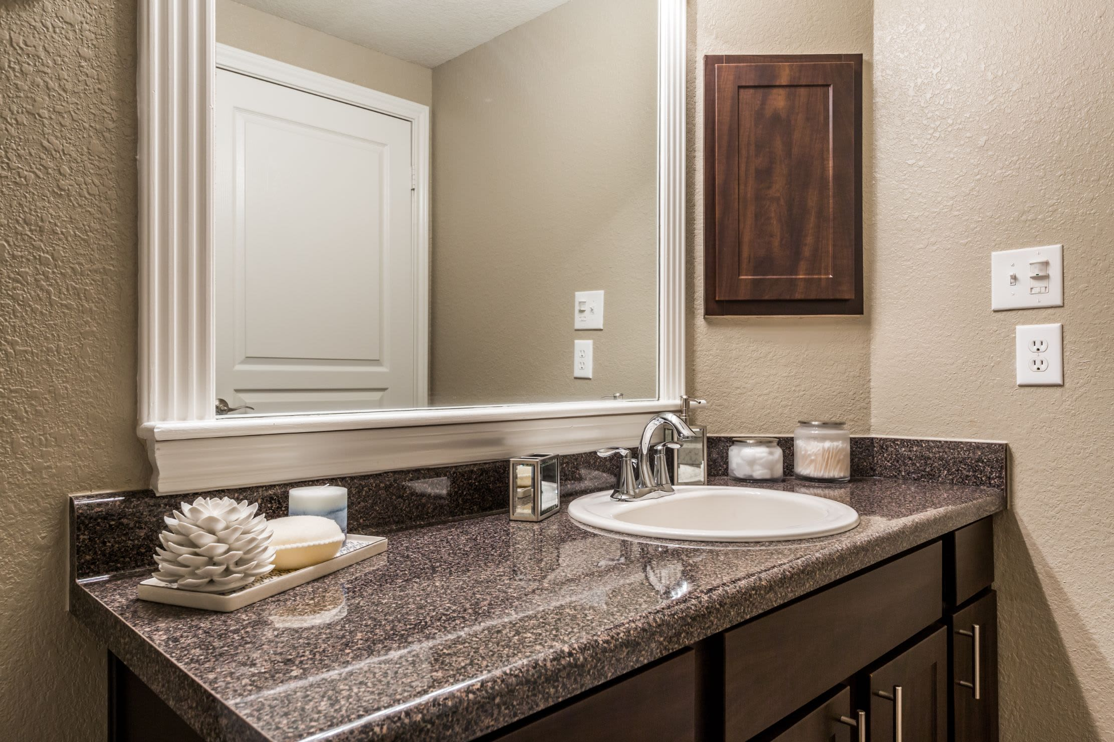 Bathroom with large mirror at Marquis at Deerfield in San Antonio, Texas