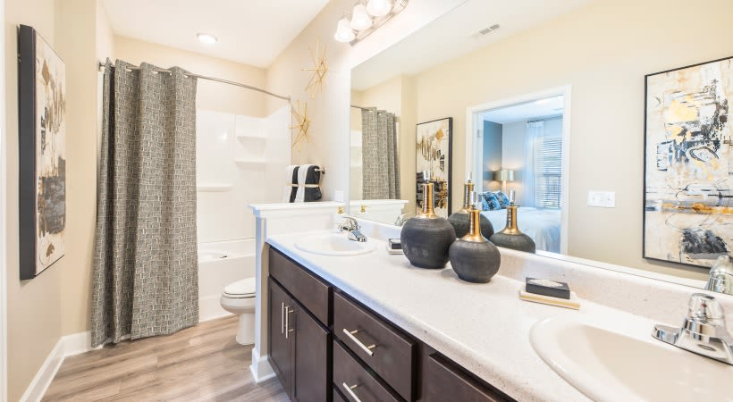 Roomy bathroom with lots of storage space under the large vanity at The Isaac in Summerville, South Carolina