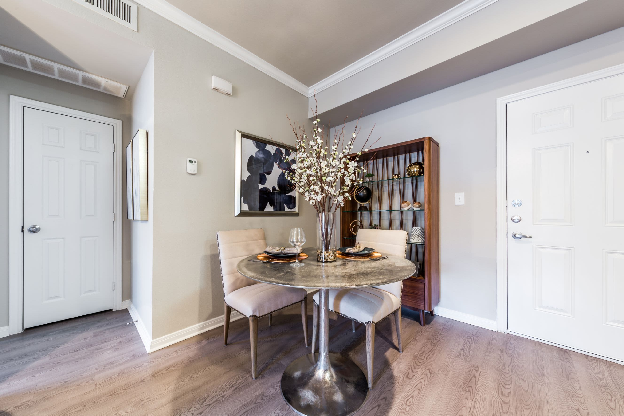 Dining area with wood style floors at Brooks on Preston in Plano, Texas