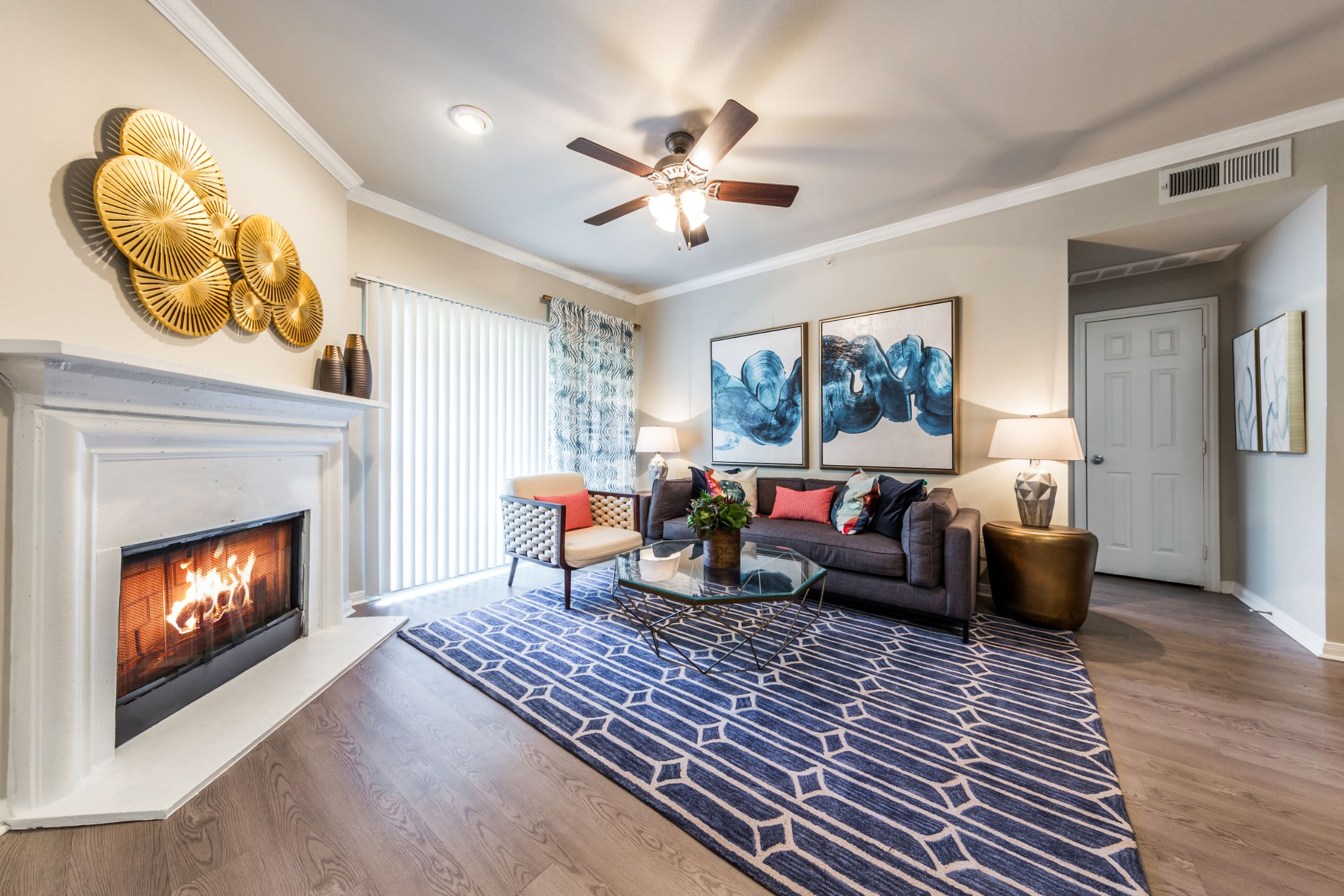Living room with a fire place at Brooks on Preston in Plano, Texas