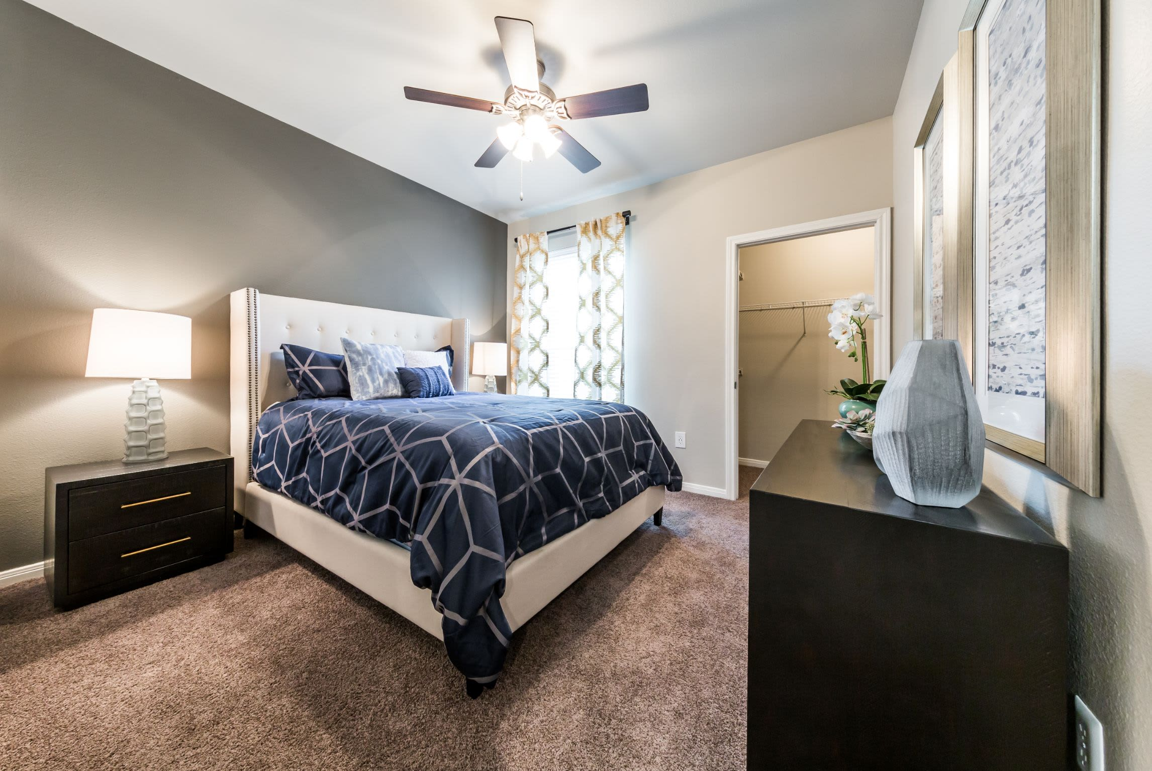 Bedroom with an accent wall at Brooks on Preston in Plano, Texas