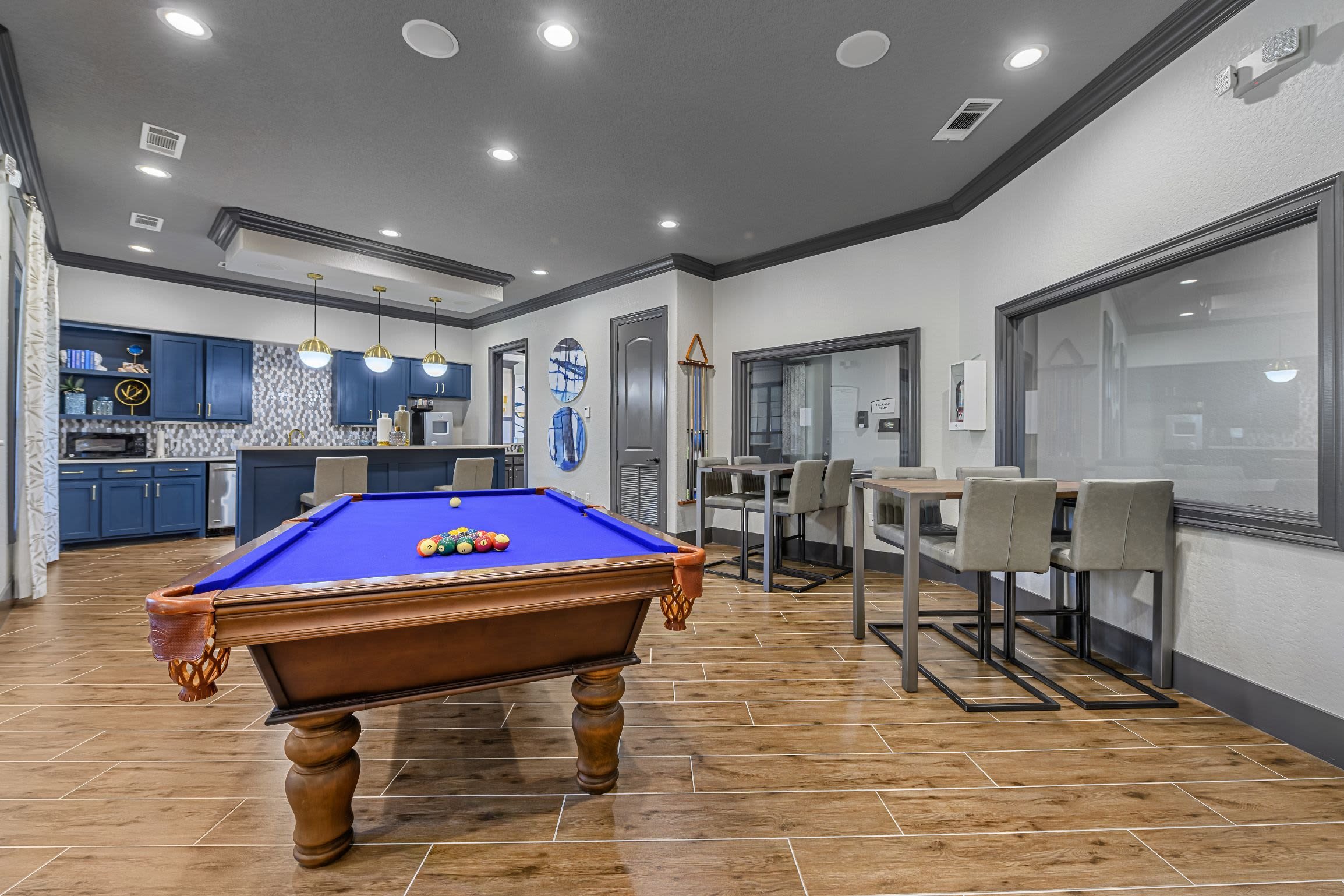 Pool table and kitchenette in clubhouse at Marquis Lakeline Station in Austin, Texas
