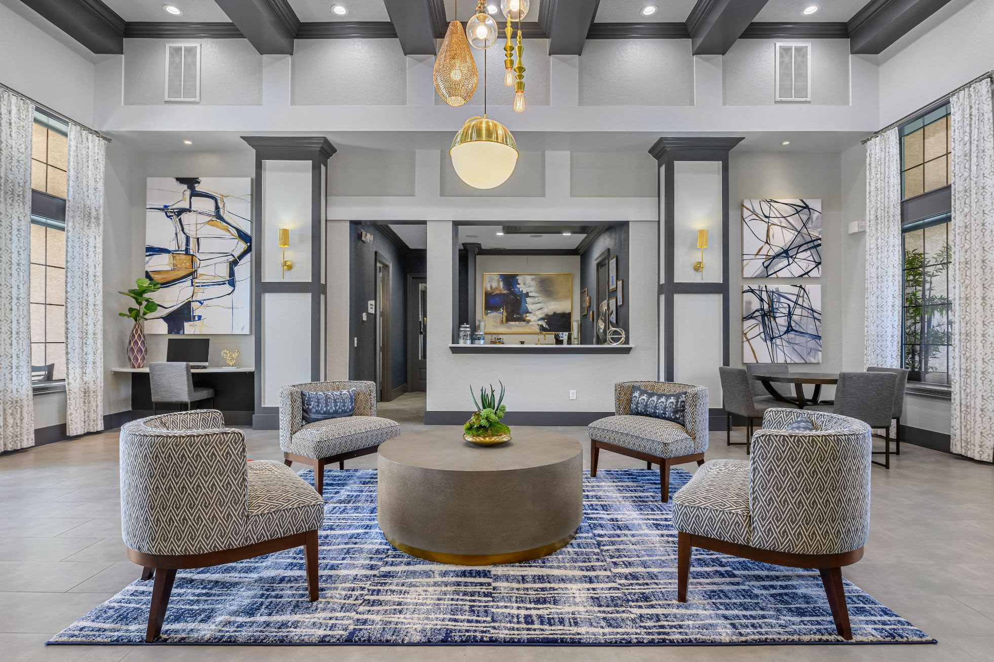 Lobby entrance with sitting area and a large rug at Marquis Lakeline Station in Austin, Texas