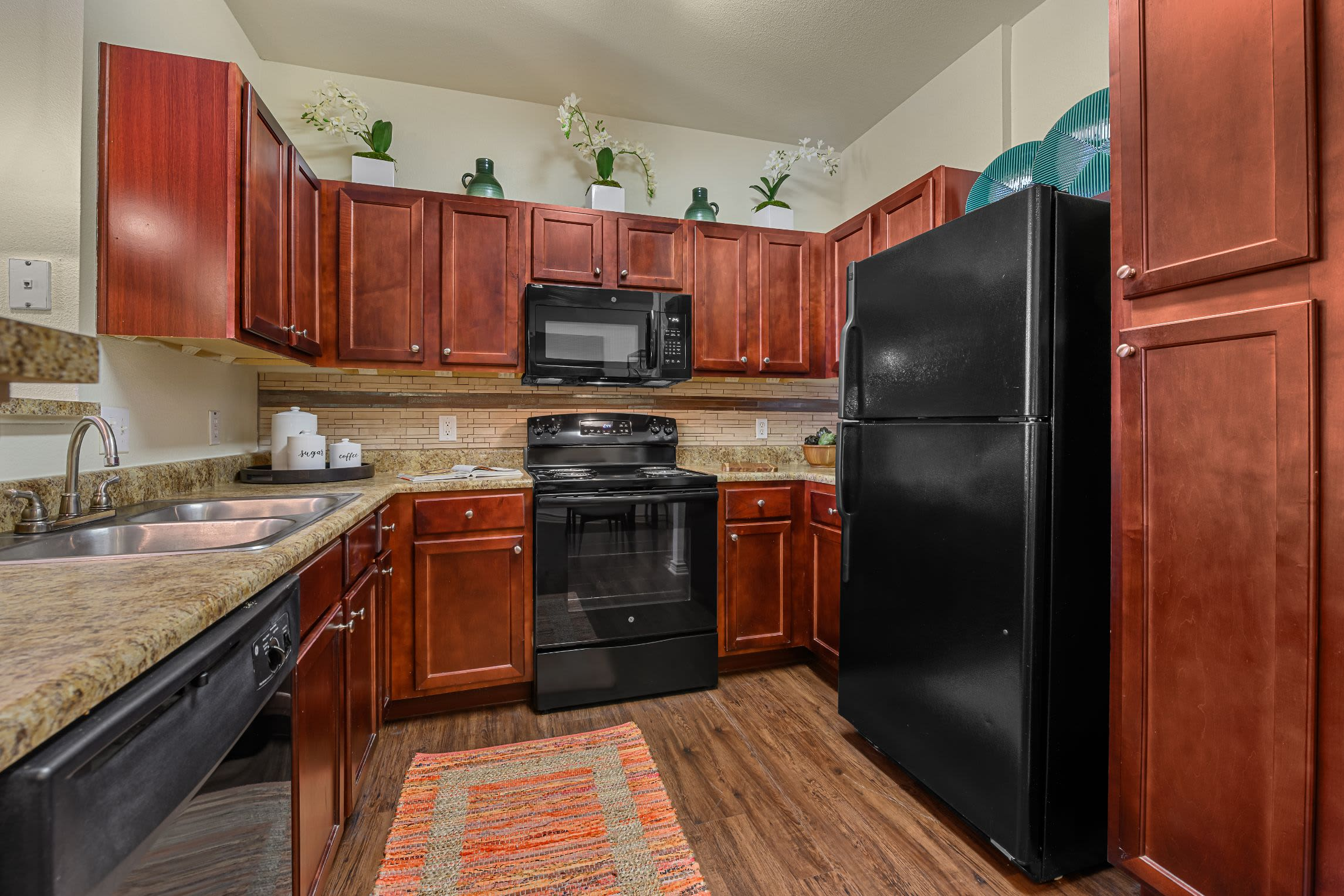 Kitchen with granite style counters at Marquis Lakeline Station in Austin, Texas