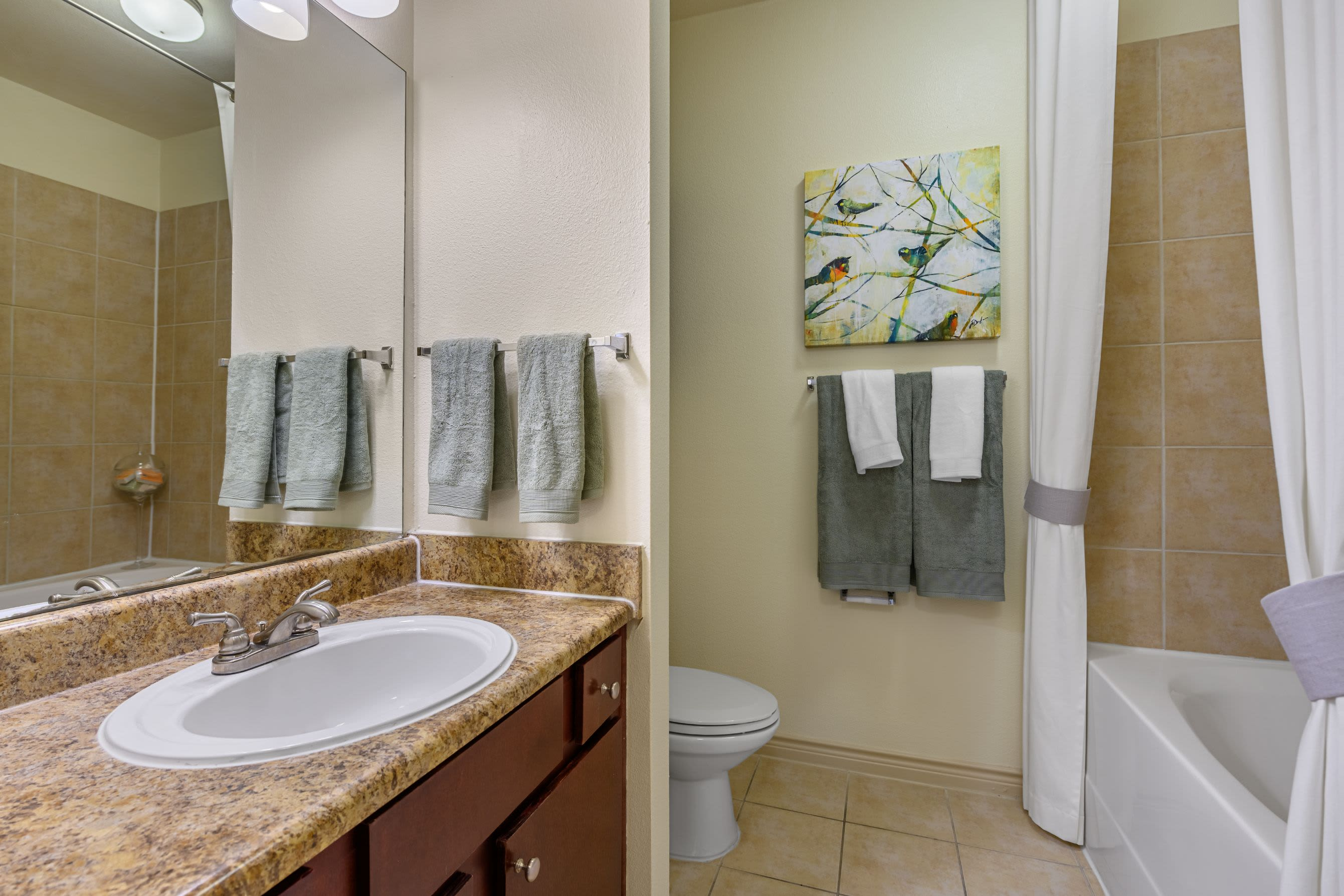 Bathroom with granite style counters at Marquis Lakeline Station in Austin, Texas