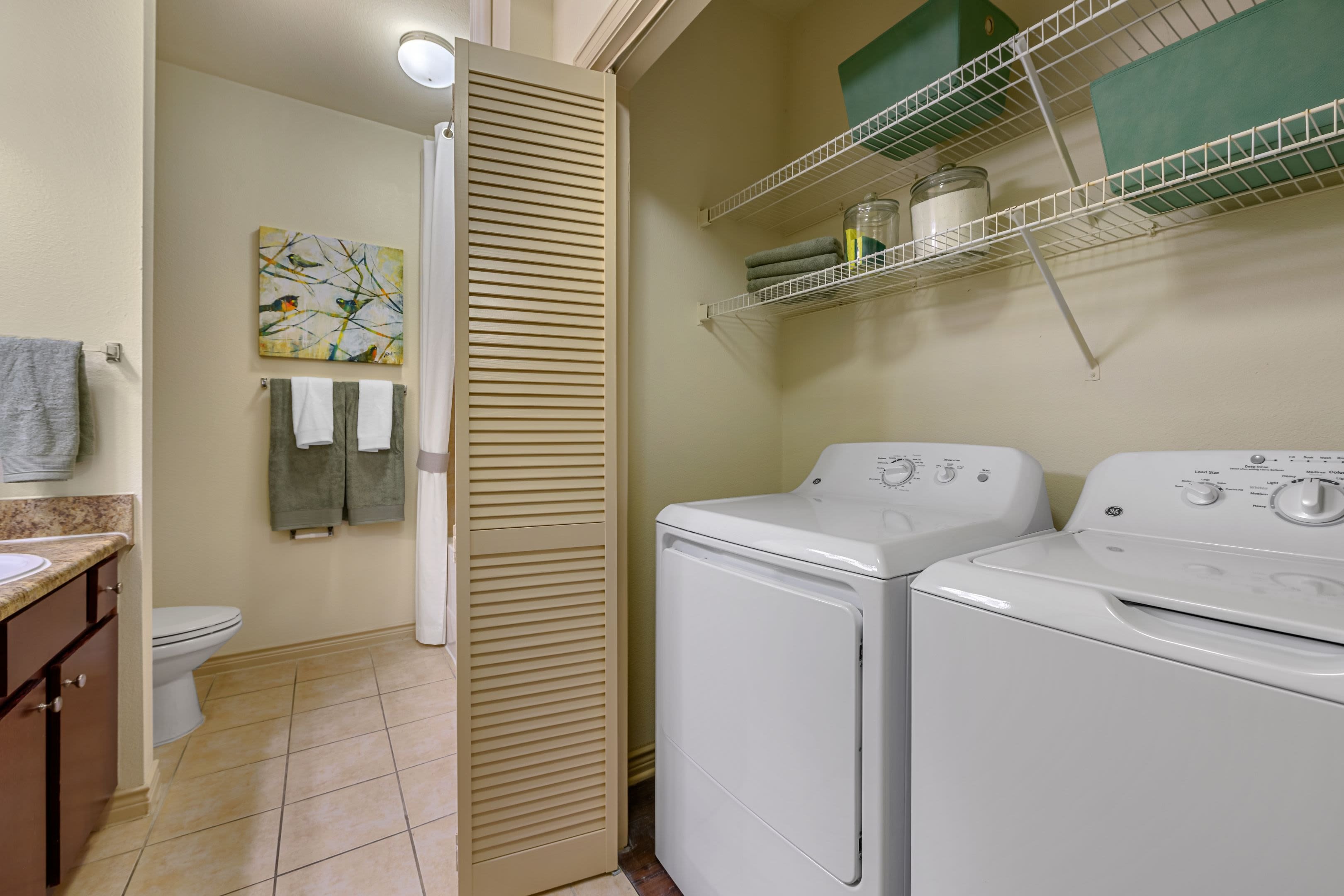 Washer and dryer in bathroom at Marquis Lakeline Station in Austin, Texas