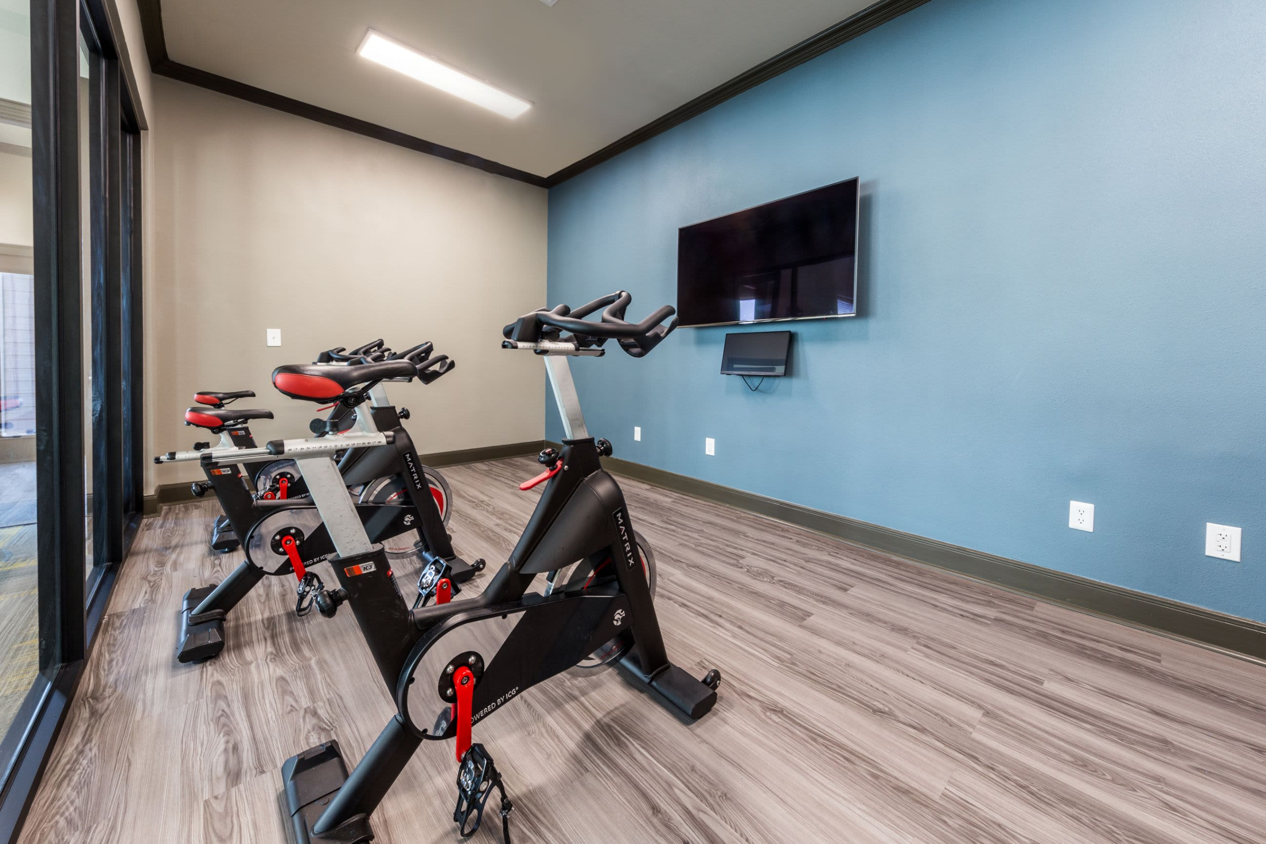 Spin cycle room with a TV at Marquis at Stonebriar in Frisco, Texas