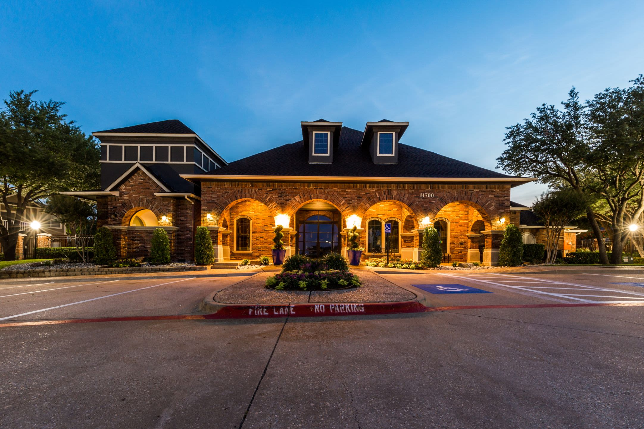 Well lit exterior of clubhouse at Marquis at Stonebriar in Frisco, Texas